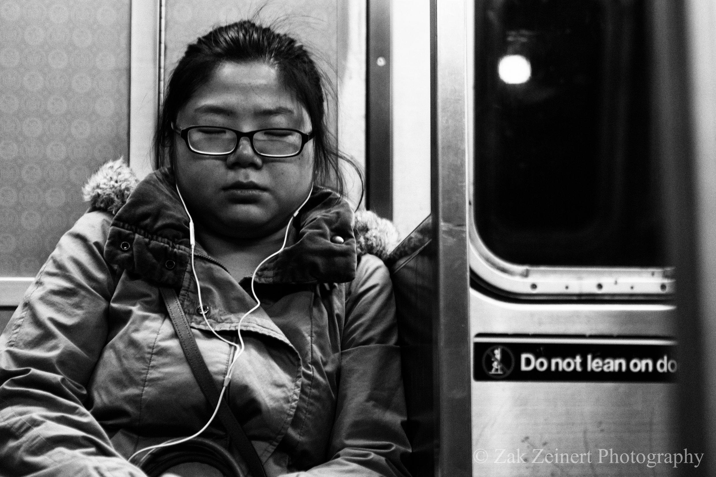 Girl sleeping on the subway