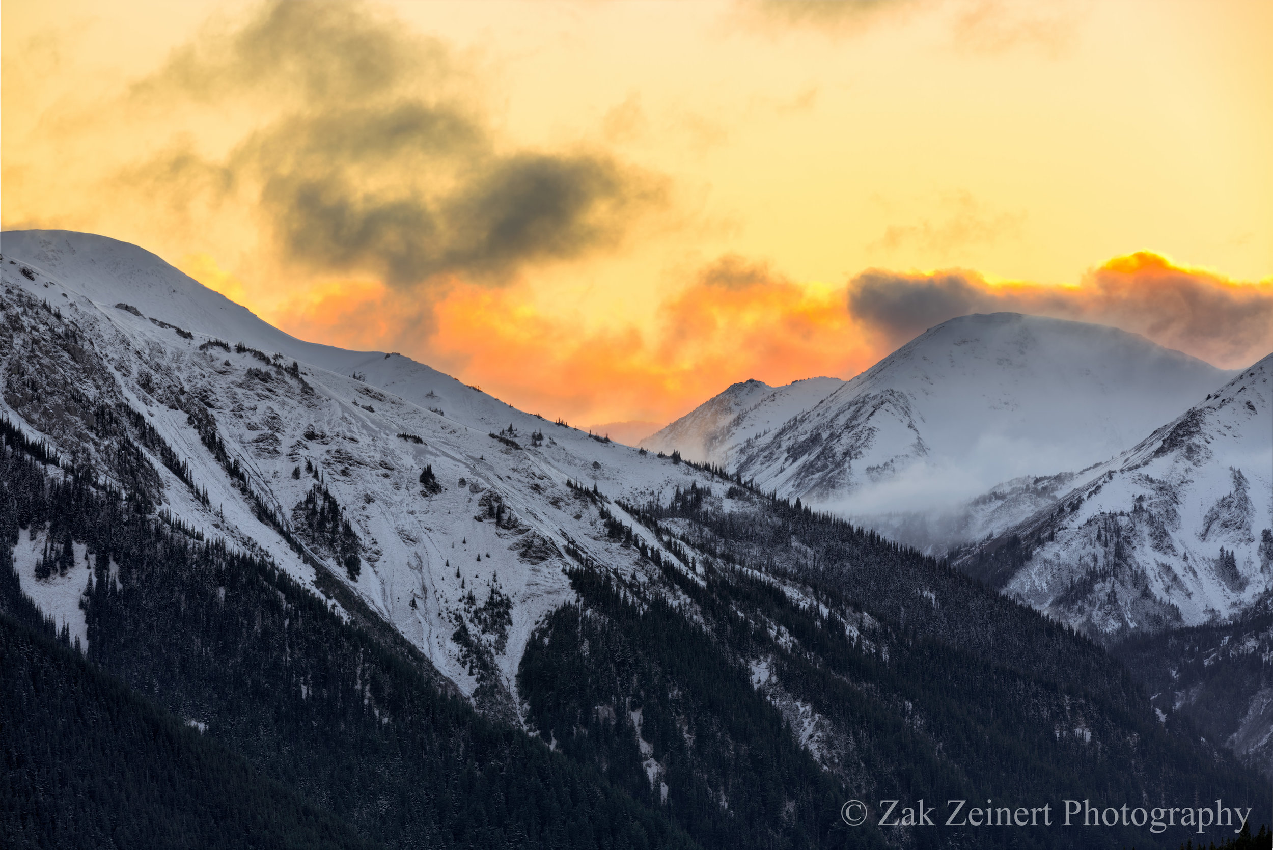 As sunset arrived, waves of orange and yellow fog rolled in, making the mountains seem on fire.