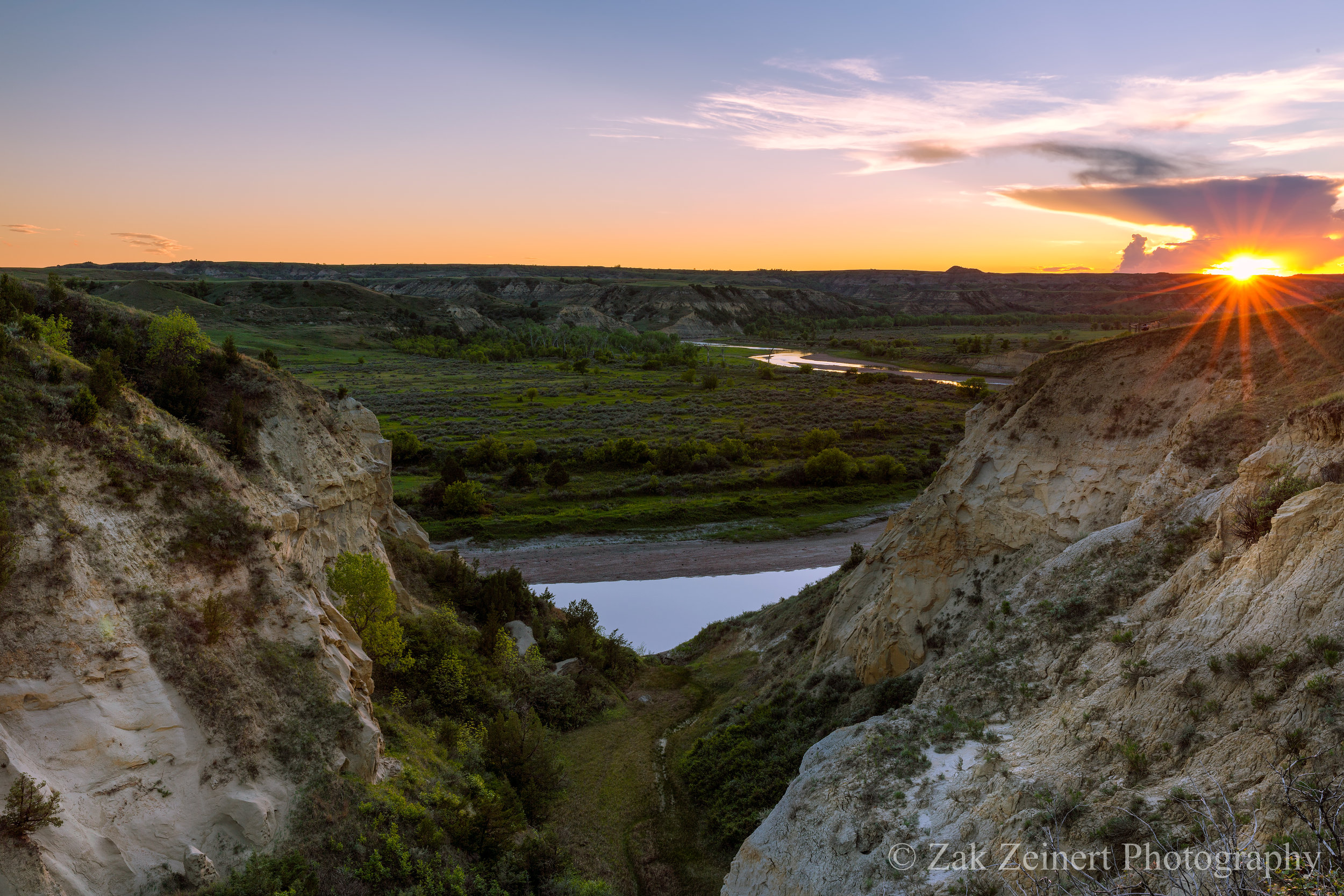The sun sets over the Little Missouri River at Wind Canyon Overlook