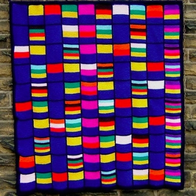 Counting Pane  : a grid of the numbers from 1 to 100. Each number cell contains the colors of the numbers from 1 to 10 that divide it, with 1 being blue, 2 being yellow, 3 red, and so on. So 12, which is divisible by 1, 2, 3, 4 and 6 has the colours of blue, yellow, red, green and black. A copy of this was sold to the Science Museum. Photograph: Pat Ashforth