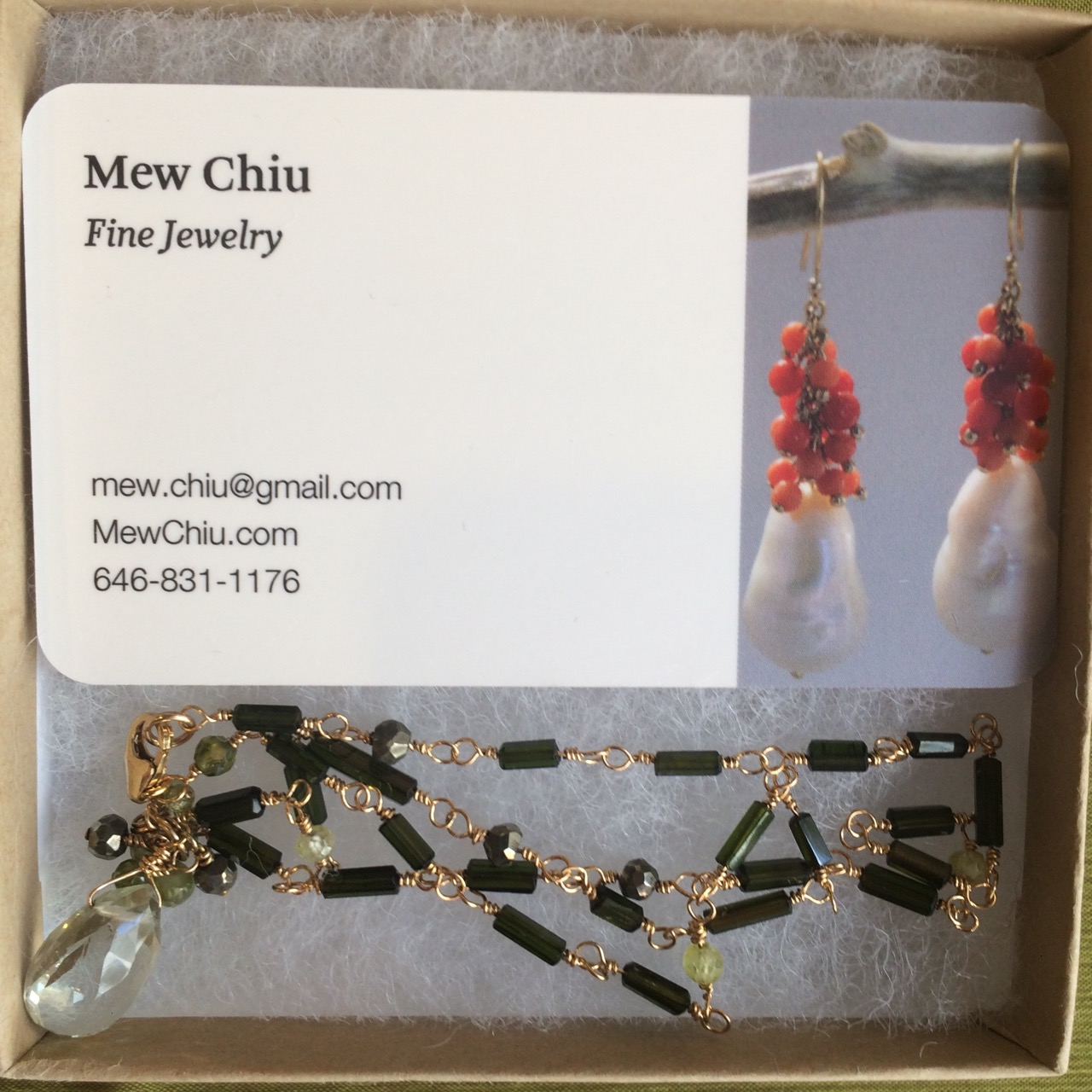 Auction Item 5: Gold-filled wire wrapped necklace with tourmaline, pyrite, green quartz and cubic zirconia beads.  Value: $150.--  Jeweler:  Mew Chiu Fine Jewelry