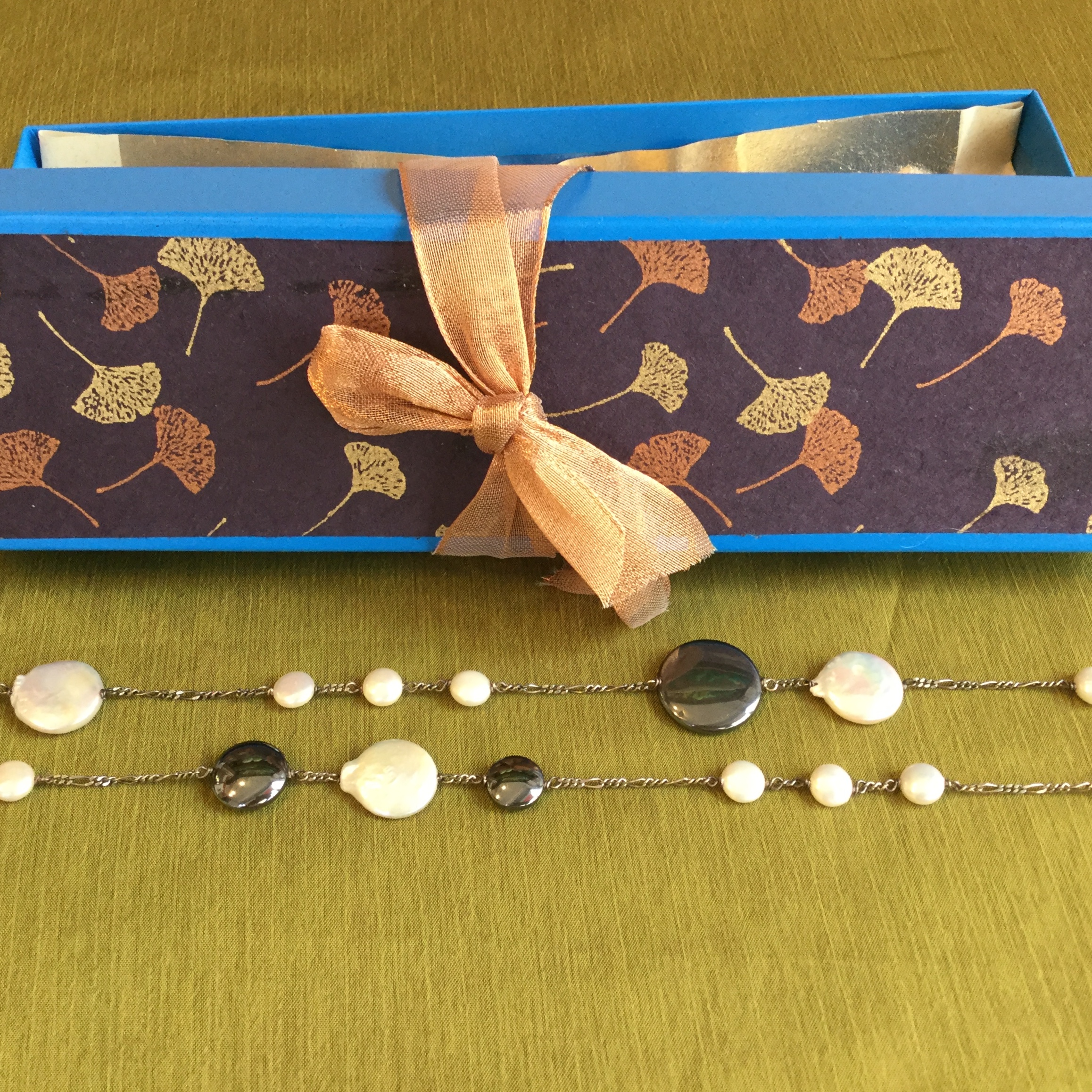 """Auction Item 08: Necklace - Silver chain hematite and coin pearl 40"""".  Value: $150.--  Jeweler: Teresa Montalvo."""