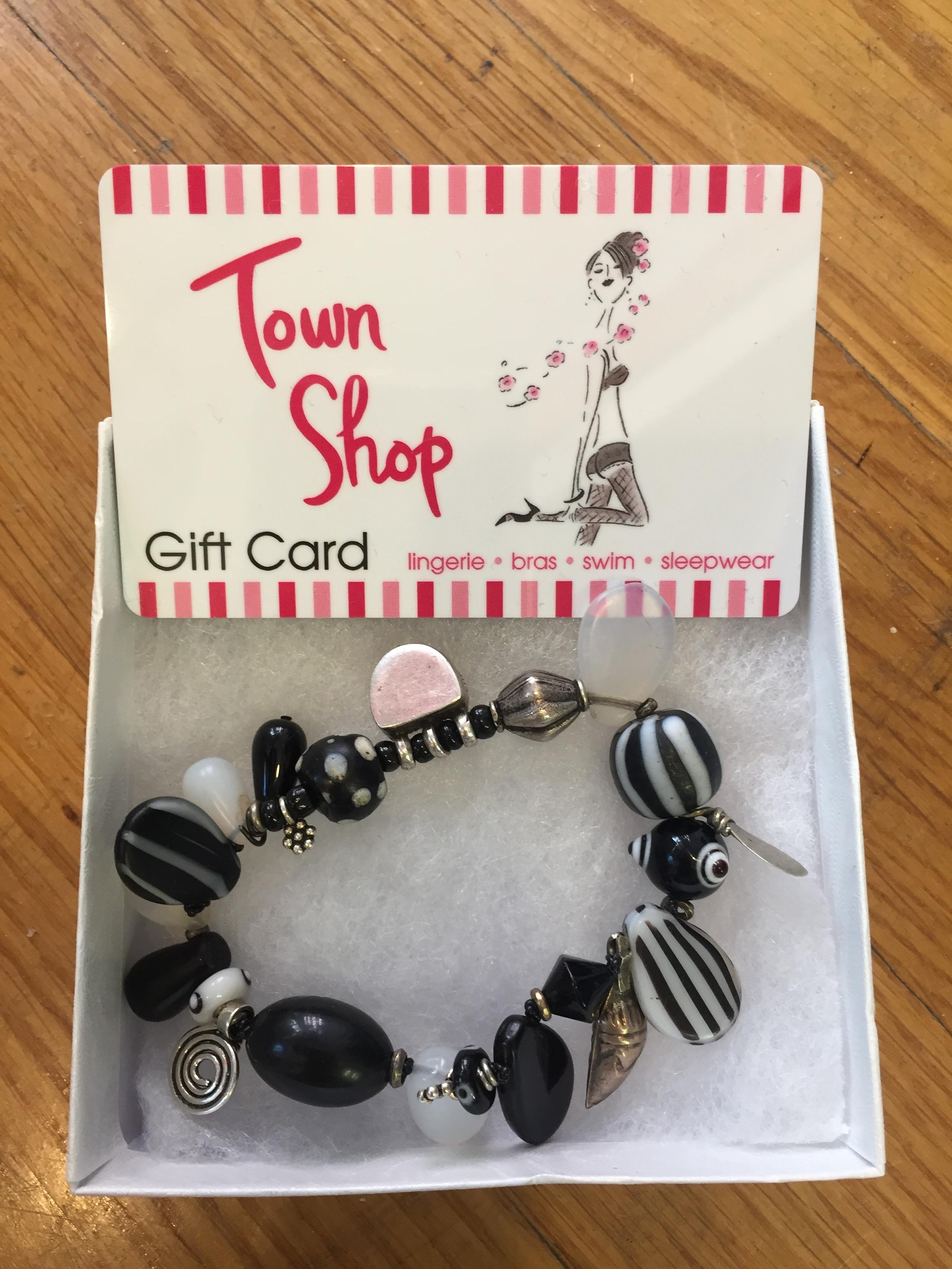 Town Shop Gift Certificate  Value: $50.-  Janet Henry Bracelet  Value: $50.-  Minimum Bid $30, increments of $10.-