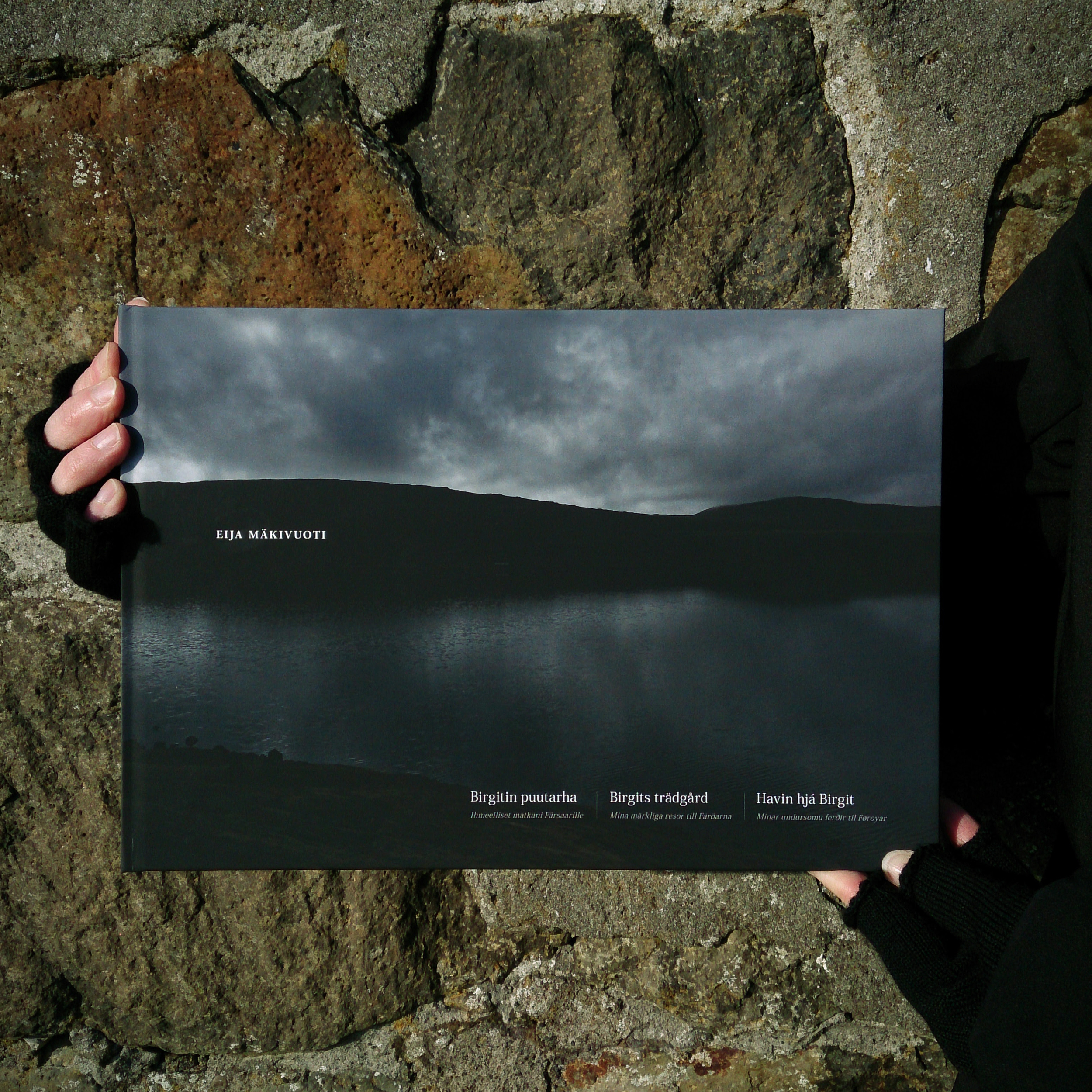 © Eija Mäkivuoti: Birgit's Garden book cover in the sun light of Tórshavn, 2015.  BIRGIT'S GARDEN, BIRGITIN PUUTARHA, BIRGITS TRÄDGÅRD, HAVIN HJÁ BIRGIT  My Wondrous Journeys to the Faroe Islands, Ihmeelliset matkani Färsaarille, Mina märkliga resor till Färöarna, Mínar undursomu ferðir til Føroyar    A Nordic photo book about the Faroe Islands by Eija Mäkivuoti.