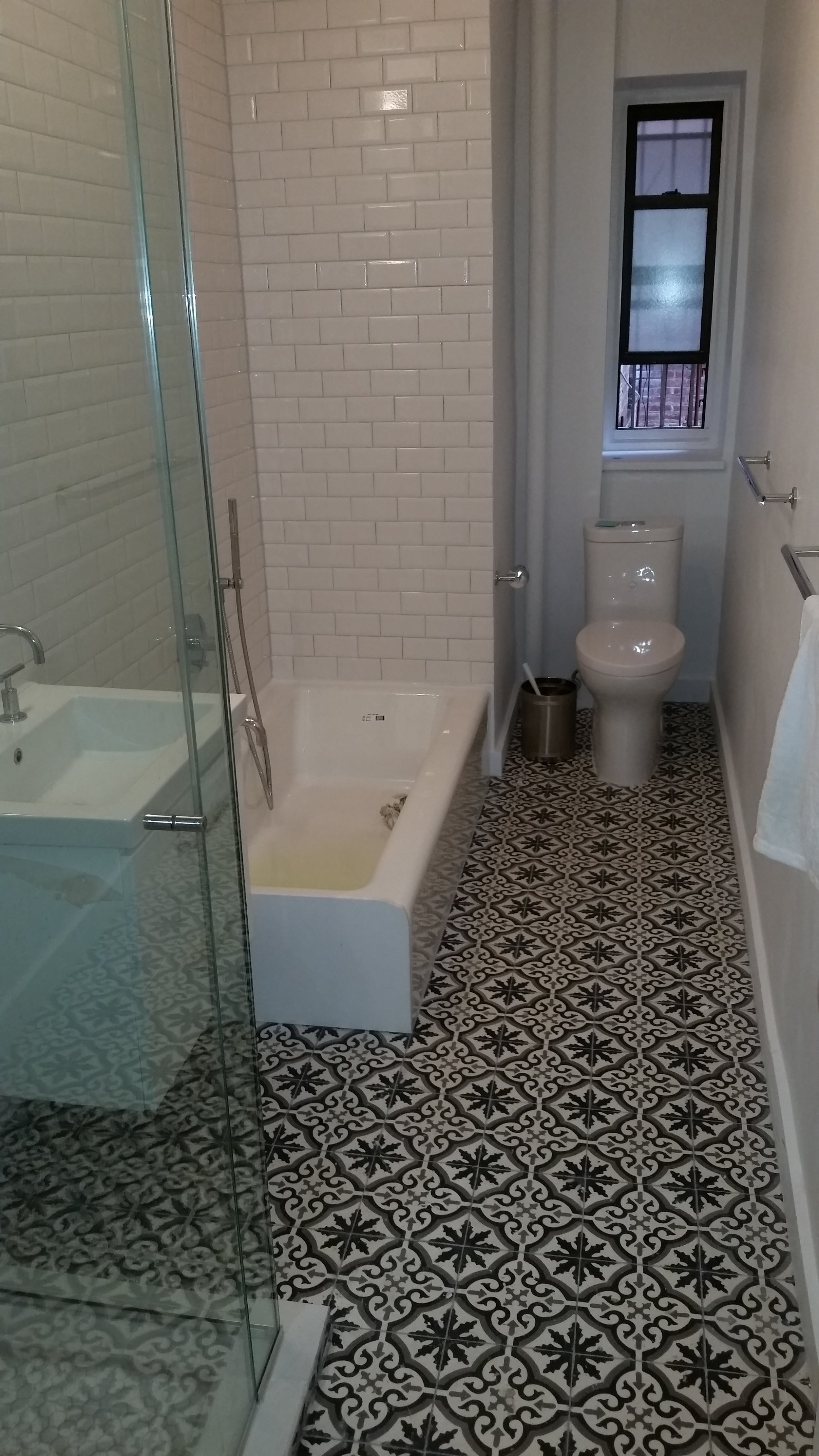 BROOKLYN BATHROOM    TYPE:  RESIDENTIAL INTERIOR RENOVATION   LOCATION:  PROSPECT HEIGHTS, BROOKLYN   SCOPE:  FULL GUT AND RENOVATION OF BATHROOM INCLUDING NEW FIXTURES, PLUMBING, LIGHTING, AND TILE WORK.