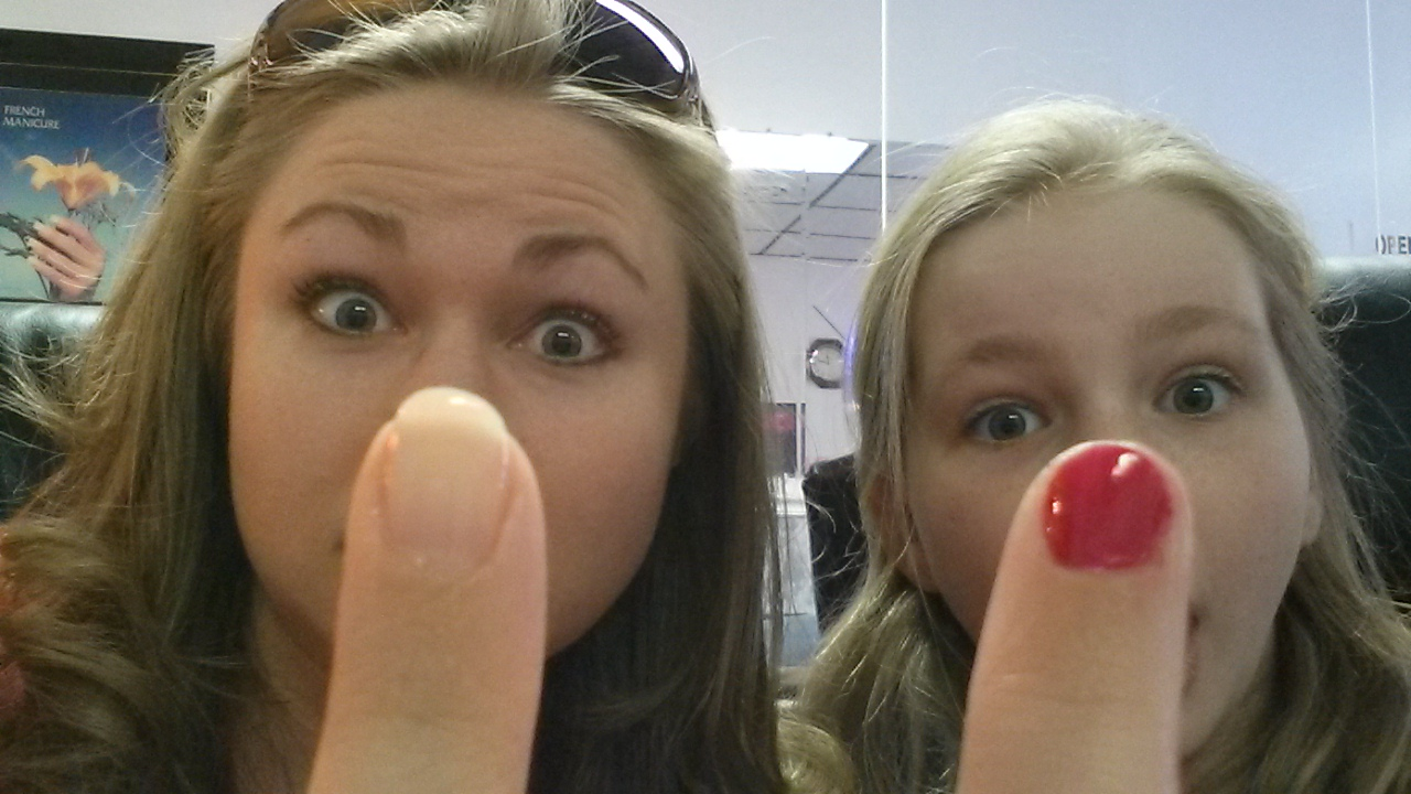2014 - Goofing off as we display our manicures for the camera...