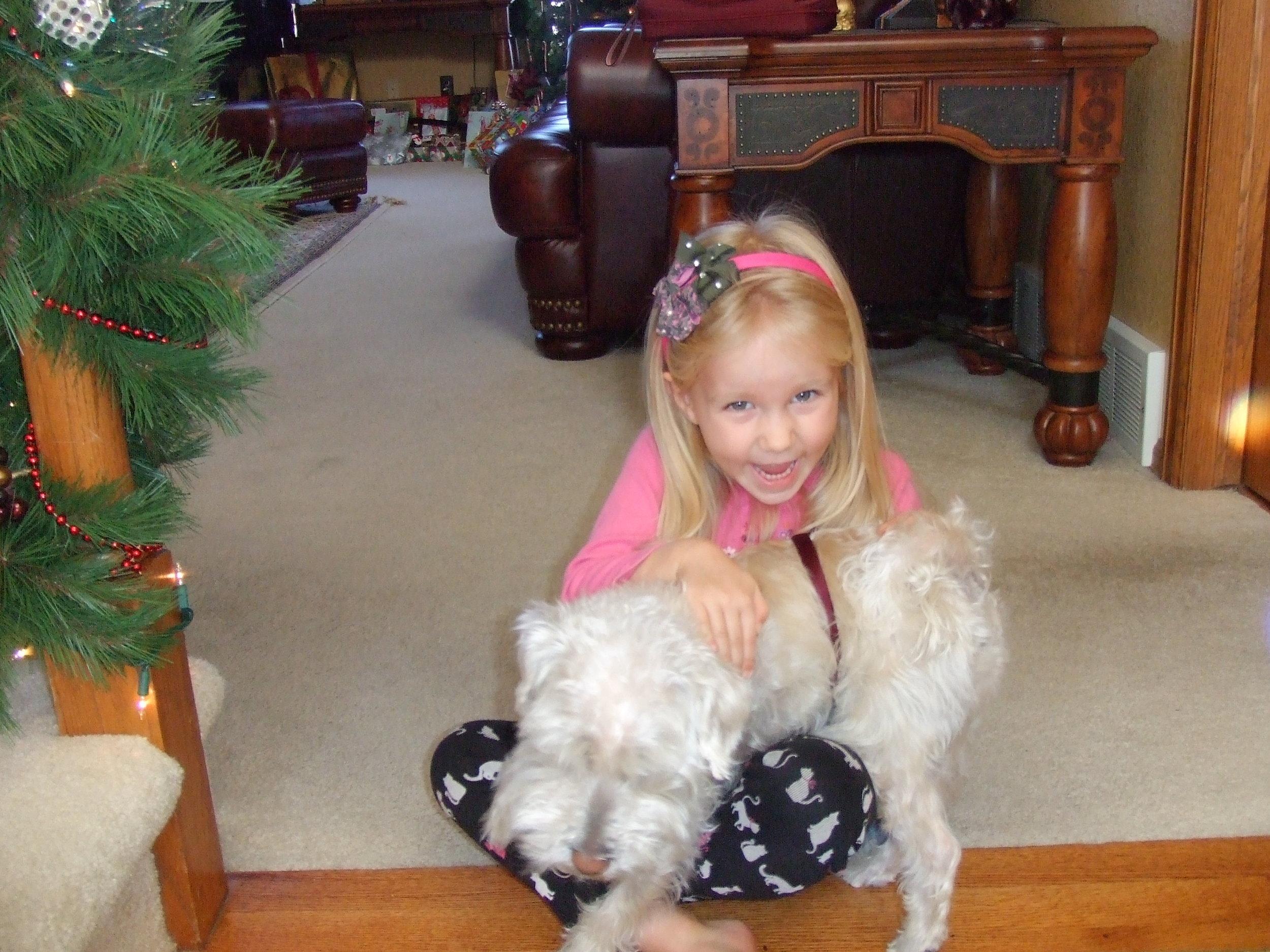 """2008 - Felicity delighting in her beloved pet dog, """"Mr. Bingley"""" ..."""
