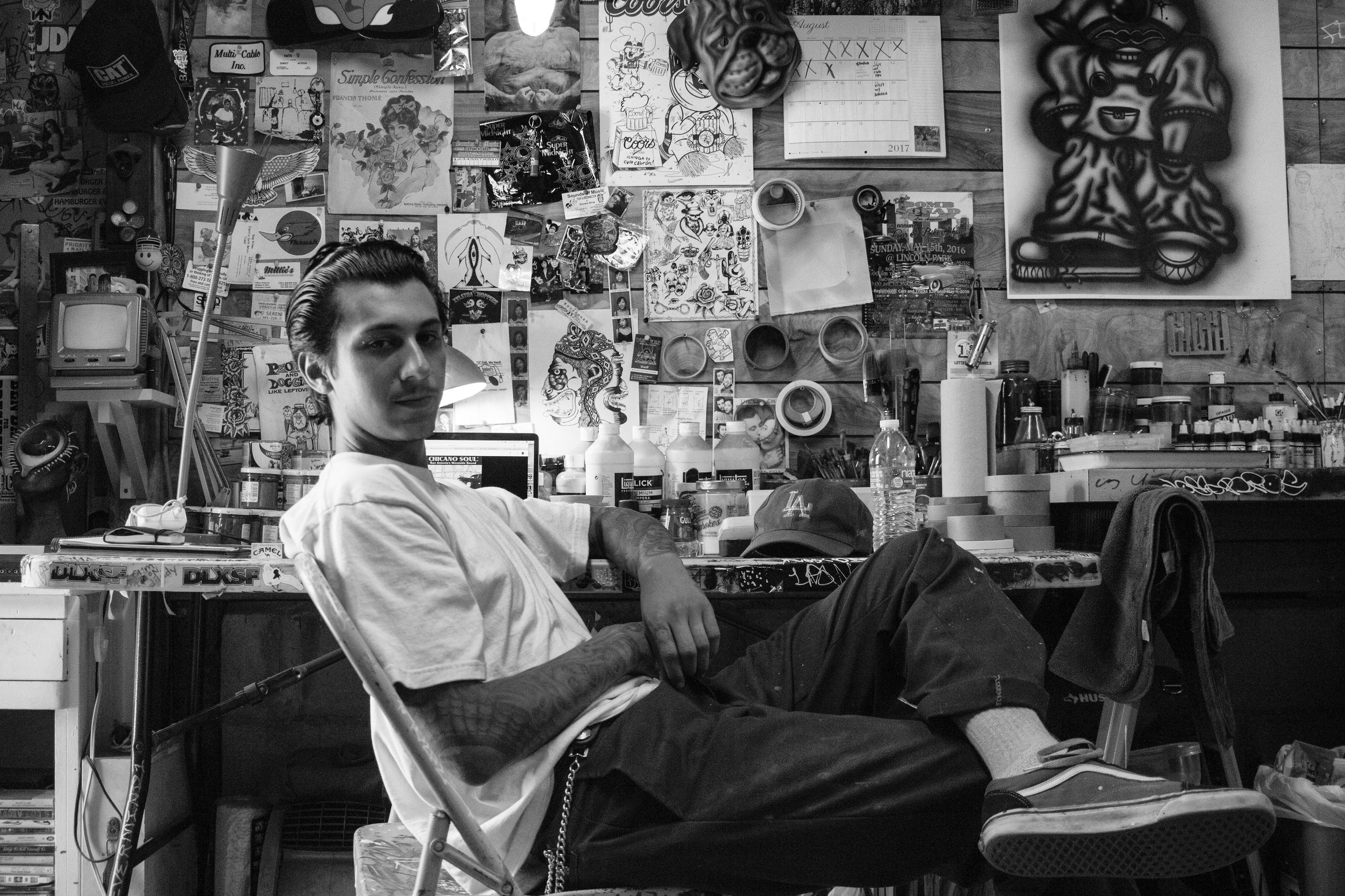 ARTIST MARIO AYALA IN HIS CHINATOWN STUDIO.