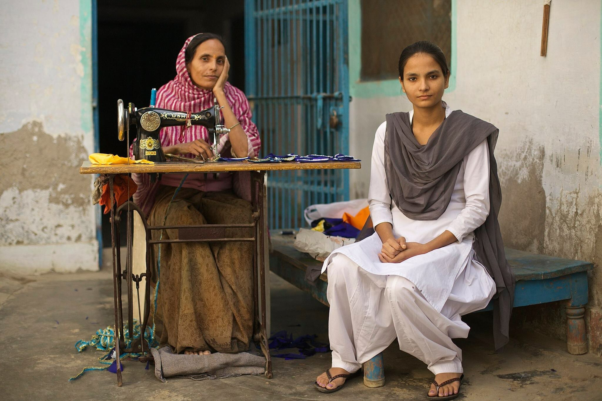 Single mother, Madhu Chaudhary (left) with daughter Mitlesh (right) in college uniform