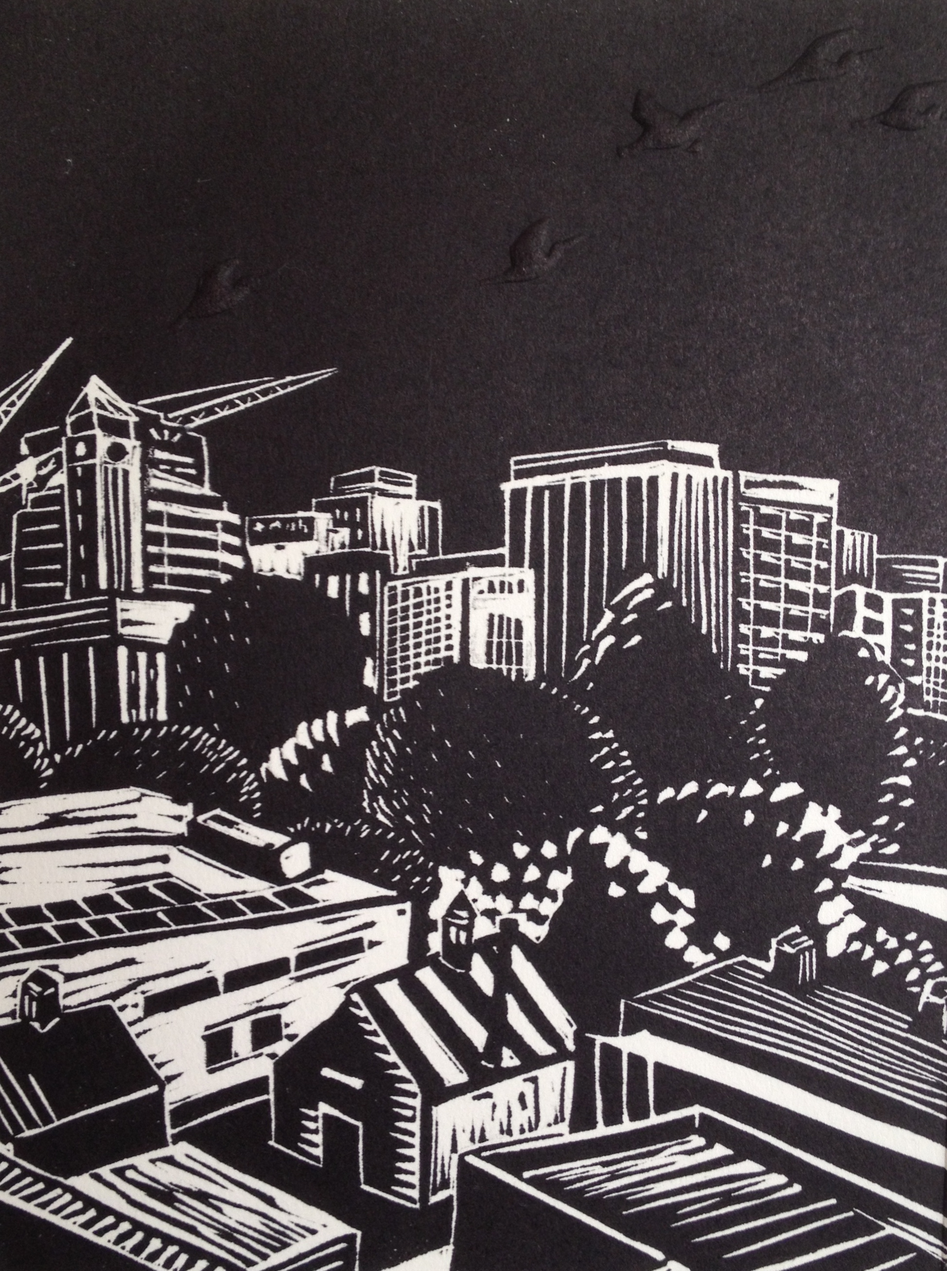 """Birds Over Adelaide: View from Schulz Building   Linocut with embossing, 2013  Edition of 3  Image size: 19 cm x 14.5 cm  Framed size:  $260 (only framed copy available)                      Normal   0           false   false   false     EN-AU   JA   X-NONE                                                                                                                                                                                                                                                                                                                                                                            /* Style Definitions */ table.MsoNormalTable {mso-style-name:""""Table Normal""""; mso-tstyle-rowband-size:0; mso-tstyle-colband-size:0; mso-style-noshow:yes; mso-style-priority:99; mso-style-parent:""""""""; mso-padding-alt:0cm 5.4pt 0cm 5.4pt; mso-para-margin:0cm; mso-para-margin-bottom:.0001pt; mso-pagination:widow-orphan; font-size:10.0pt; font-family:""""Times New Roman"""";}          Birds over Adelaide: View from Schulz Building    is inspired by the constantly changing skyline of Adelaide and the numerous cranes and construction sites currently seen in the city. Birds flying are symbols of the enlivening of Adelaide and our growth towards the sky."""