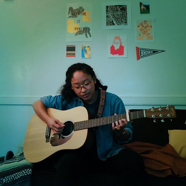 "B-SIDE Tent Show Artist Feature: Mako Mendoza!! B-SIDE is thrilled to have Mako (Class of 2021) playing for us this THURSDAY! Mako Mendoza is a indie-folk-pop singer/songwriter from Fredricksburg, VA. You may recognise her from her performance at Vagabond Mag's 'Hot Chocolate' in the Underground earlier this semester. We had the absolute pleasure of getting to sit down with her and talk with her about music, and life in general.  Mako's regular playlists consists of artists such as Bon Inver, Sufjan Stevens, Dr. Dog, The Eagles, Asgeir, and James Vincent McMorrow. Her inspiration mainly comes from the likes of Ben Howard and Gabrielle Aplin.  On writing her own music: ""Songwriting is such a good outlet for me because I have a lot of emotions and I hardly ever know how to make sense of them or how to disentangle them from the mess they are in my head. Picking those feelings apart into manageable pieces and turning them into some kind of art just makes me feel so much lighter and so much more -- I don't want to say 'in control' because that's not exactly it -- but so much more in harmony with whatever it is that I'm feeling. I thinking I would implode if I didn't have this outlet."" Come see this talented and radiant person perform at 7:30pm this Thursday on Simmons Quad!!! TENT SHOW COUNTDOWN: 2 DAYS!!!!"