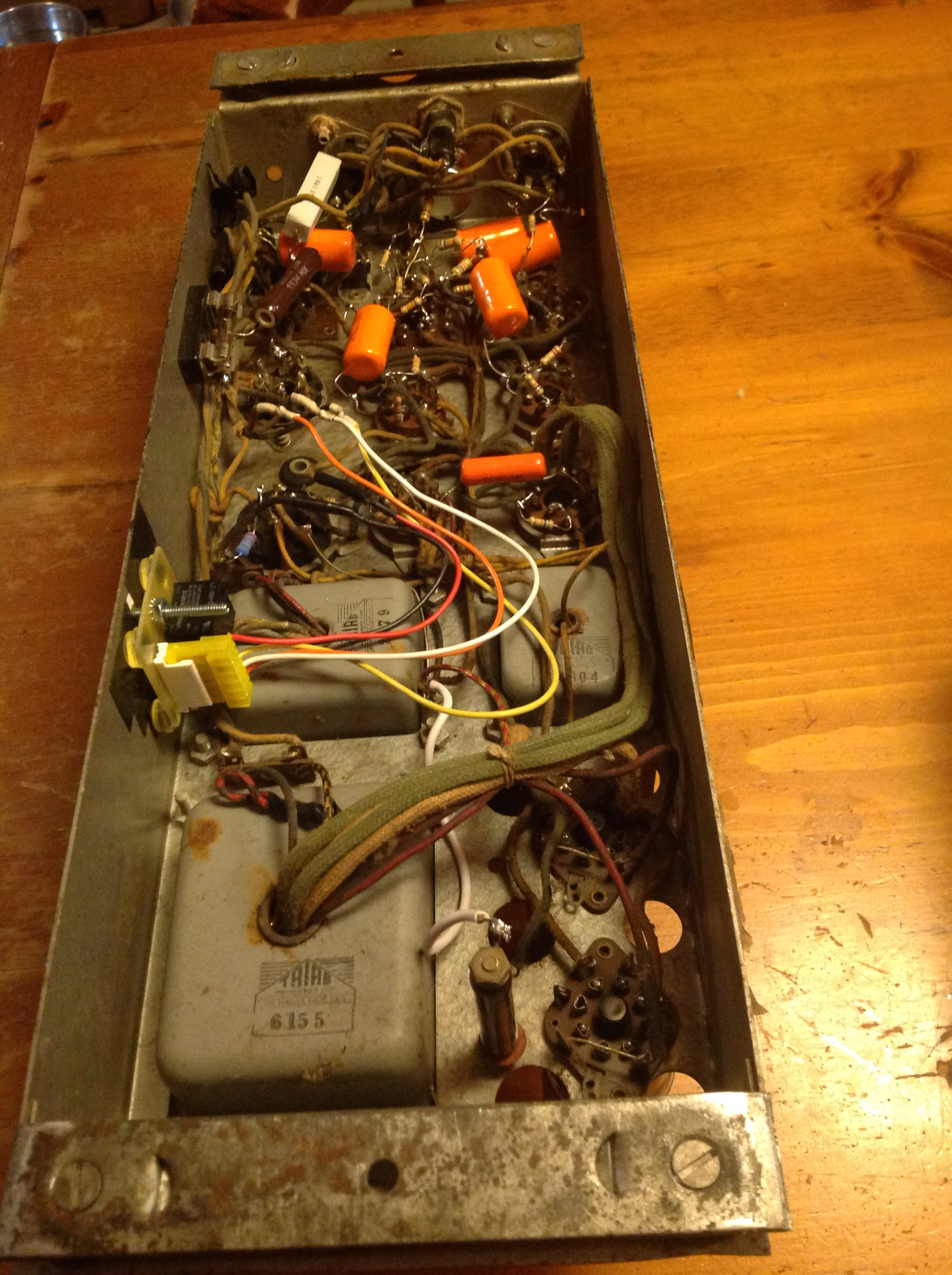 New capacitors, resistors, and relay installed, wiring restored to standard configuration.