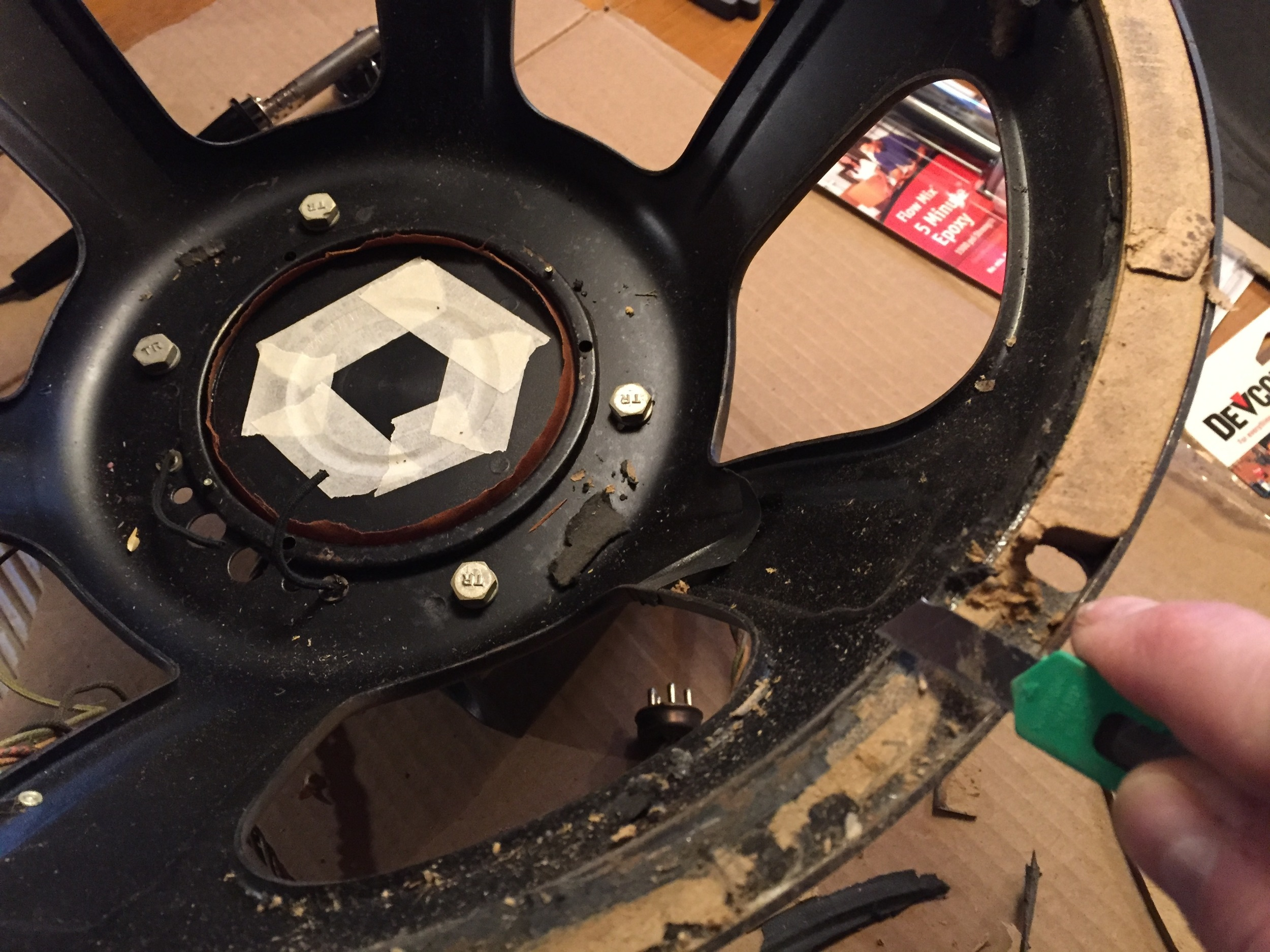 Removing the old gasket material.