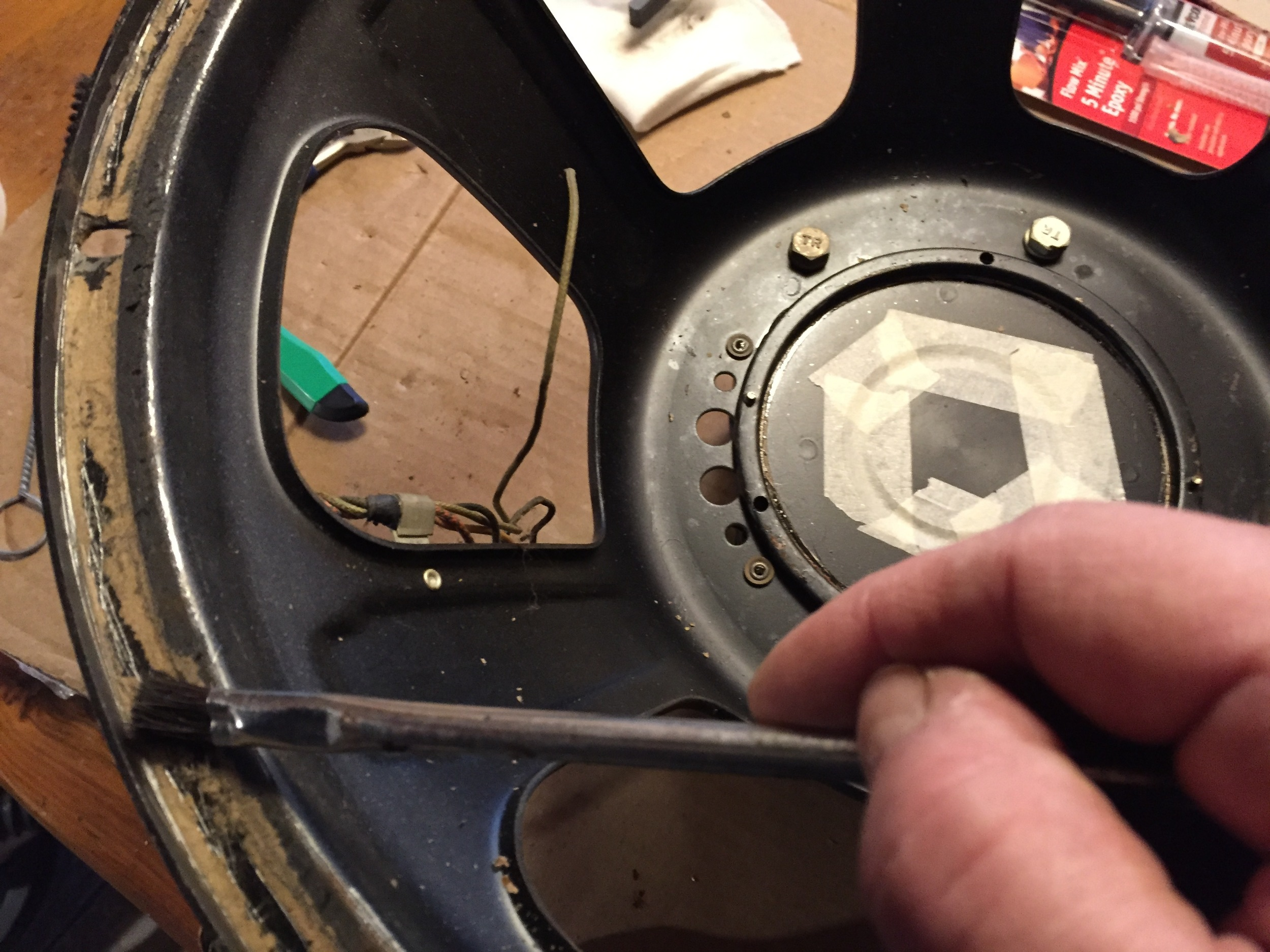 Applying new edge adhesive.