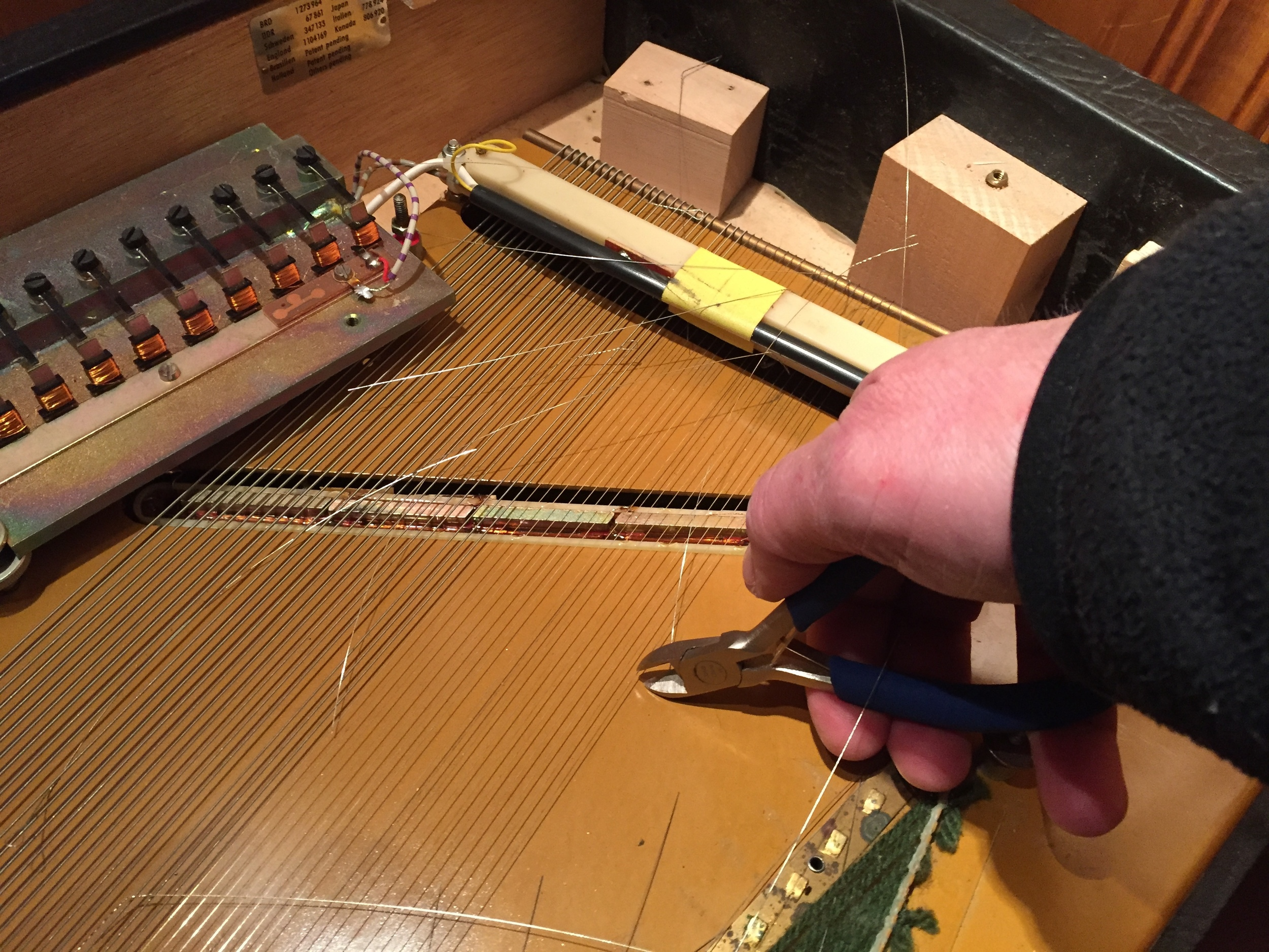 Cutting away the old strings.