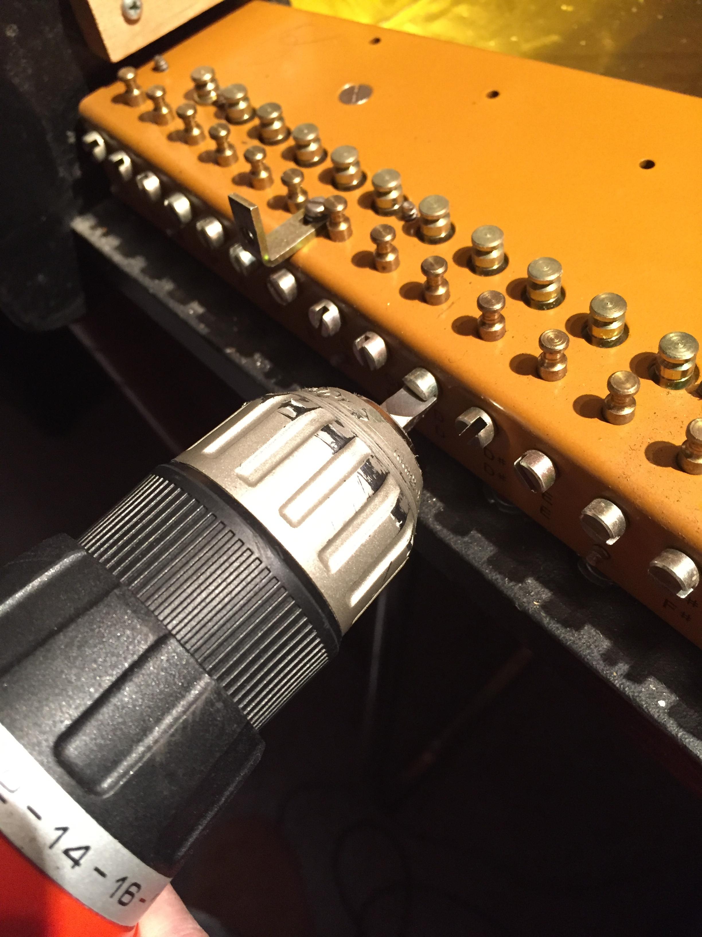 Aligning all the tuner holes for easier restringing.