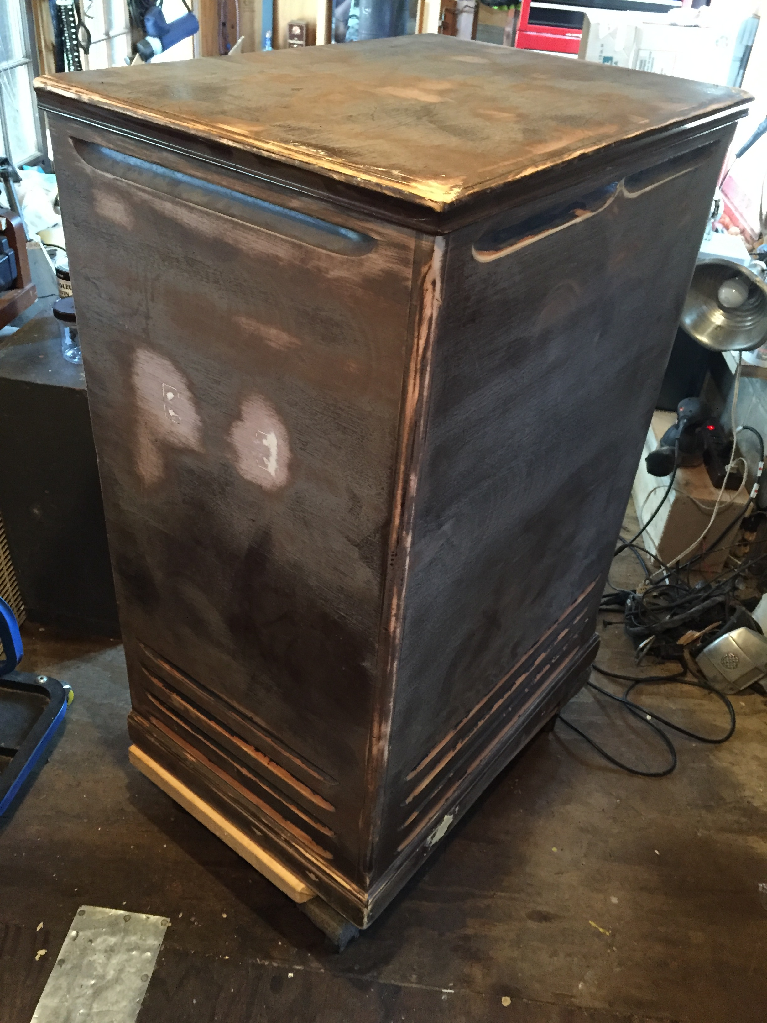 Handles removed, holes filled, cabinet sanded.