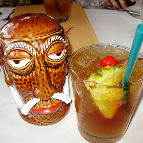 The famous Mr. Goof tiki mug next to a Mai Tai at Bali Hai