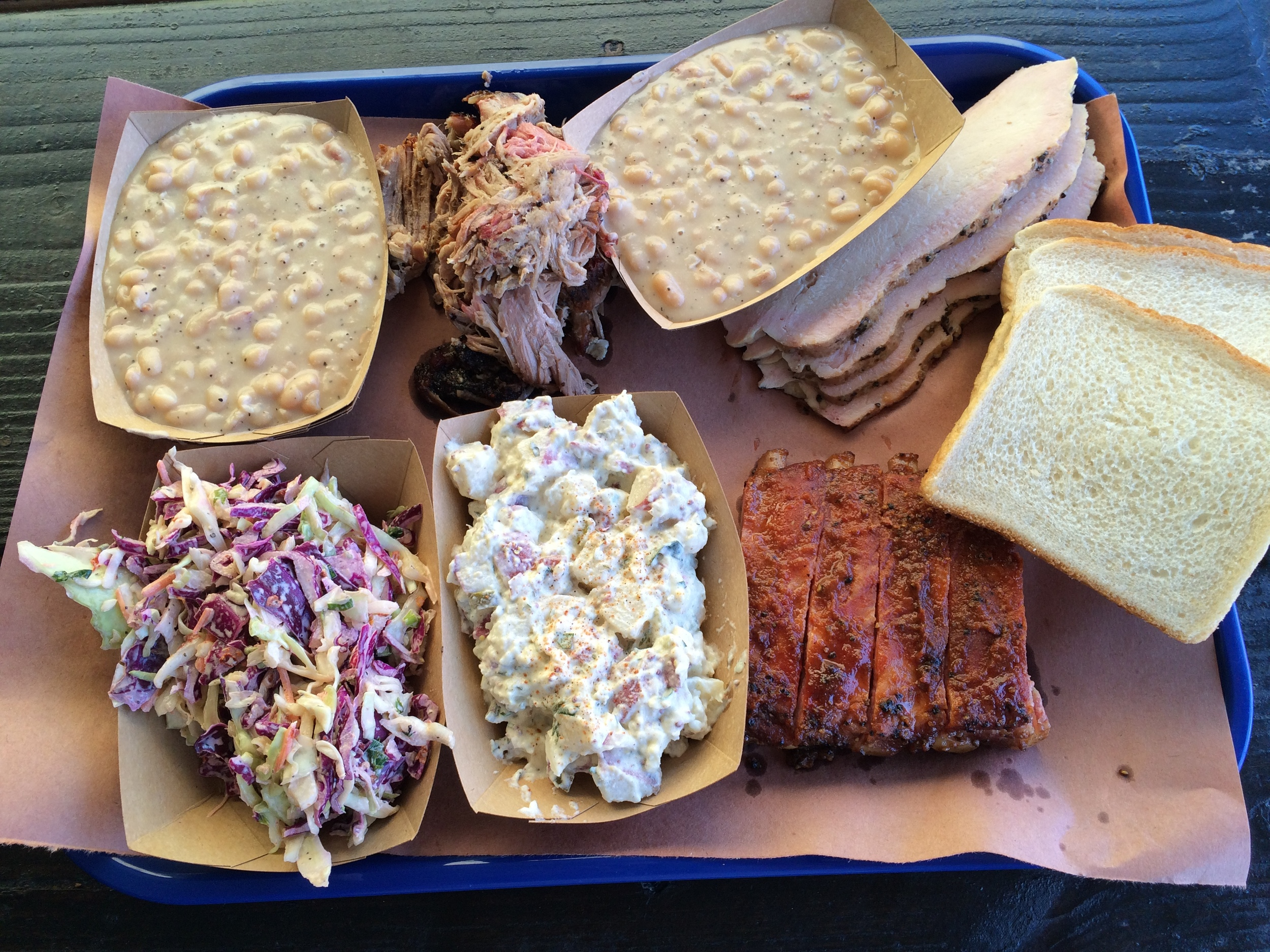 Beans, pulled pork, more beans (my wife loves them), smoked turkey, cole slaw, potato salad, and pork ribs - and yes, white bread!