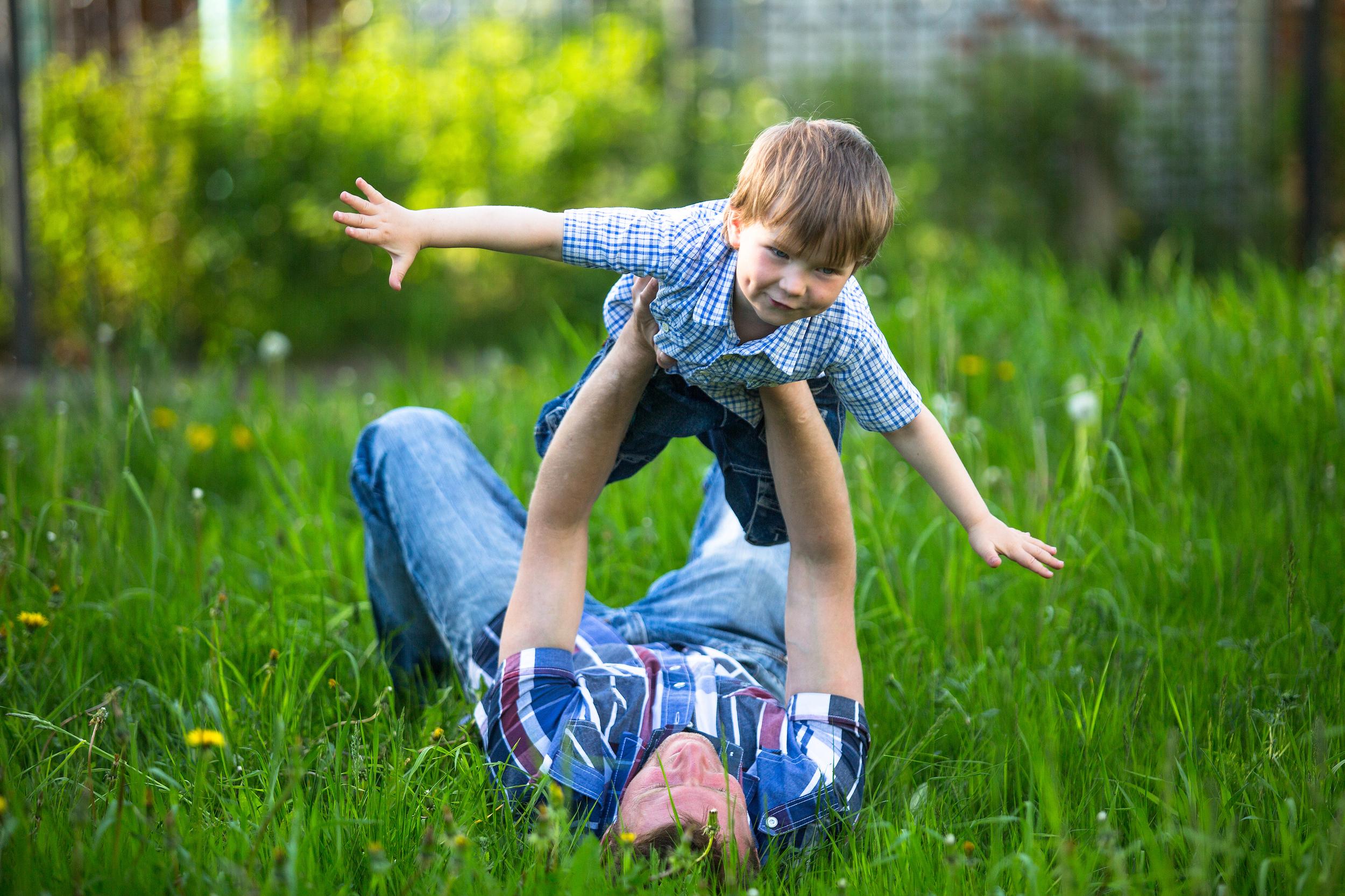 bigstock-Father-and-son-playing-lying-o-46173241.jpg