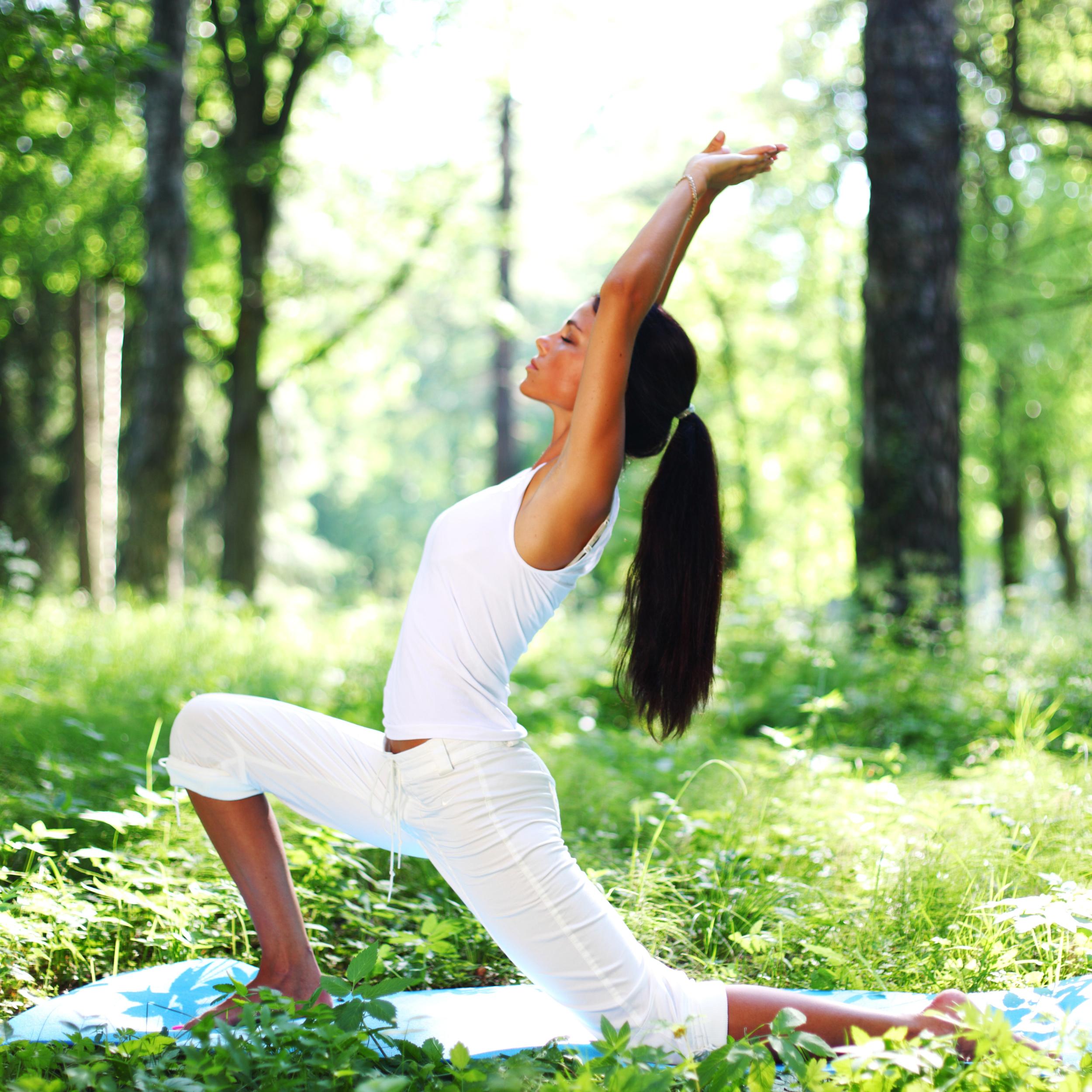 bigstock-yoga-woman-on-green-park-12509636.jpg