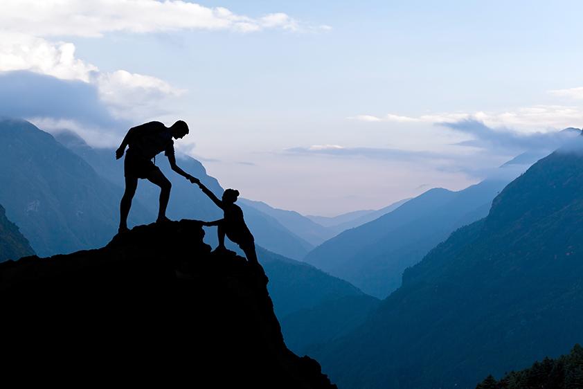 bigstock-Teamwork-Couple-Climbing-Helpi-91037114 small.jpg
