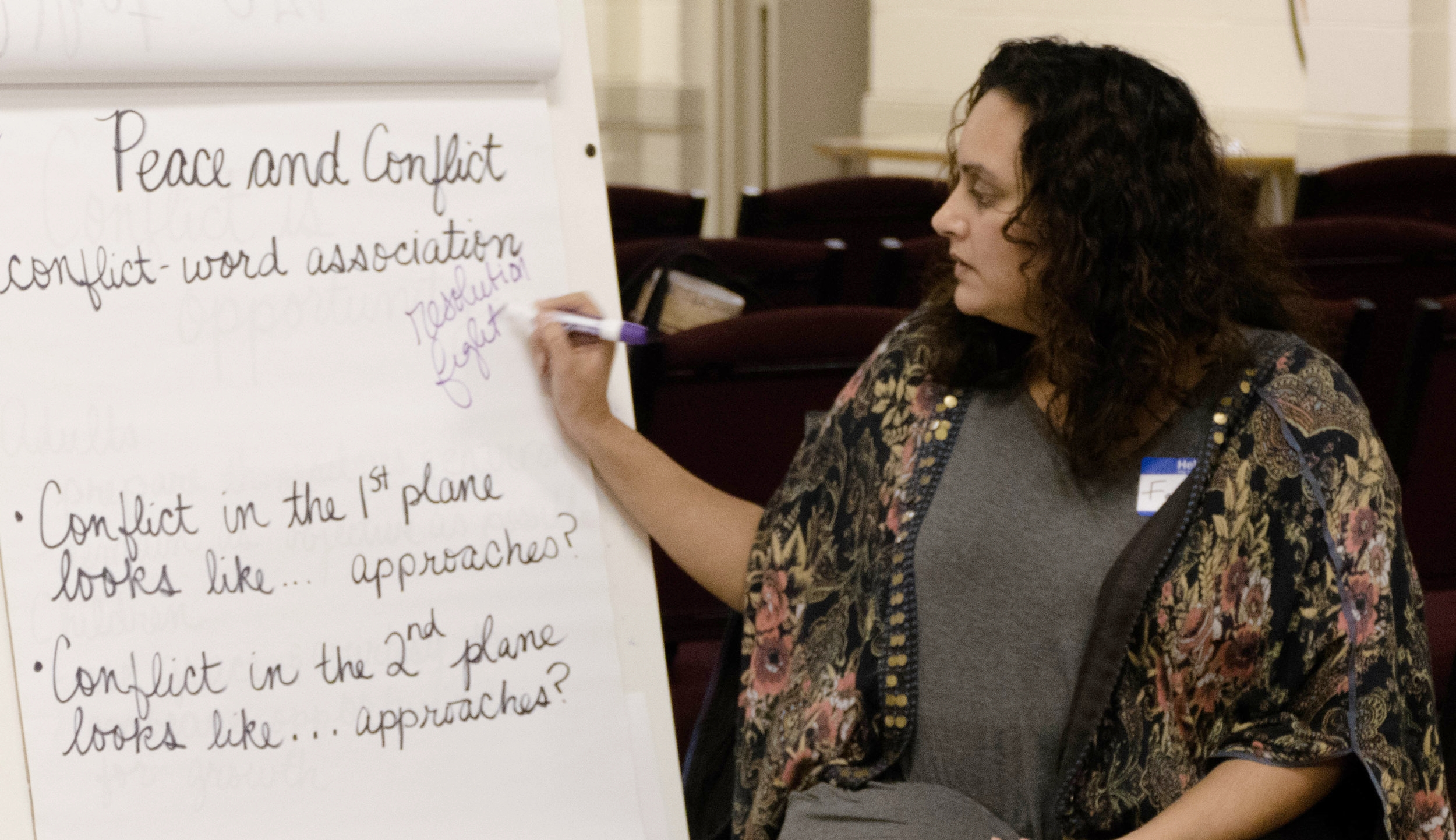 """Through calling out other words they associate with the word """"conflict,"""" caregivers examined their understanding of conflict."""