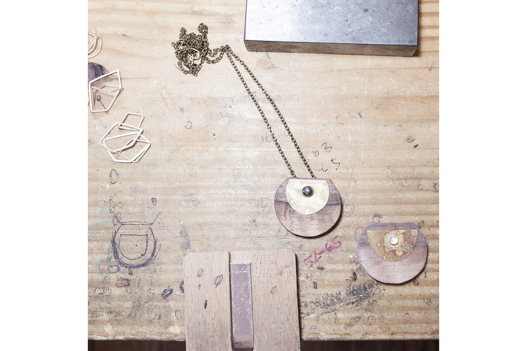 A pendant and an in-process pendant.