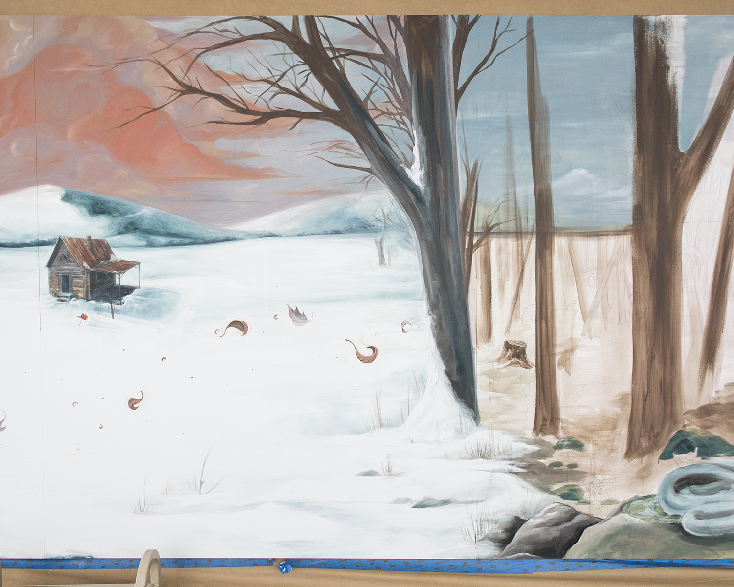 Finished cabin and sky on the left. Underpainting on trees to the right.