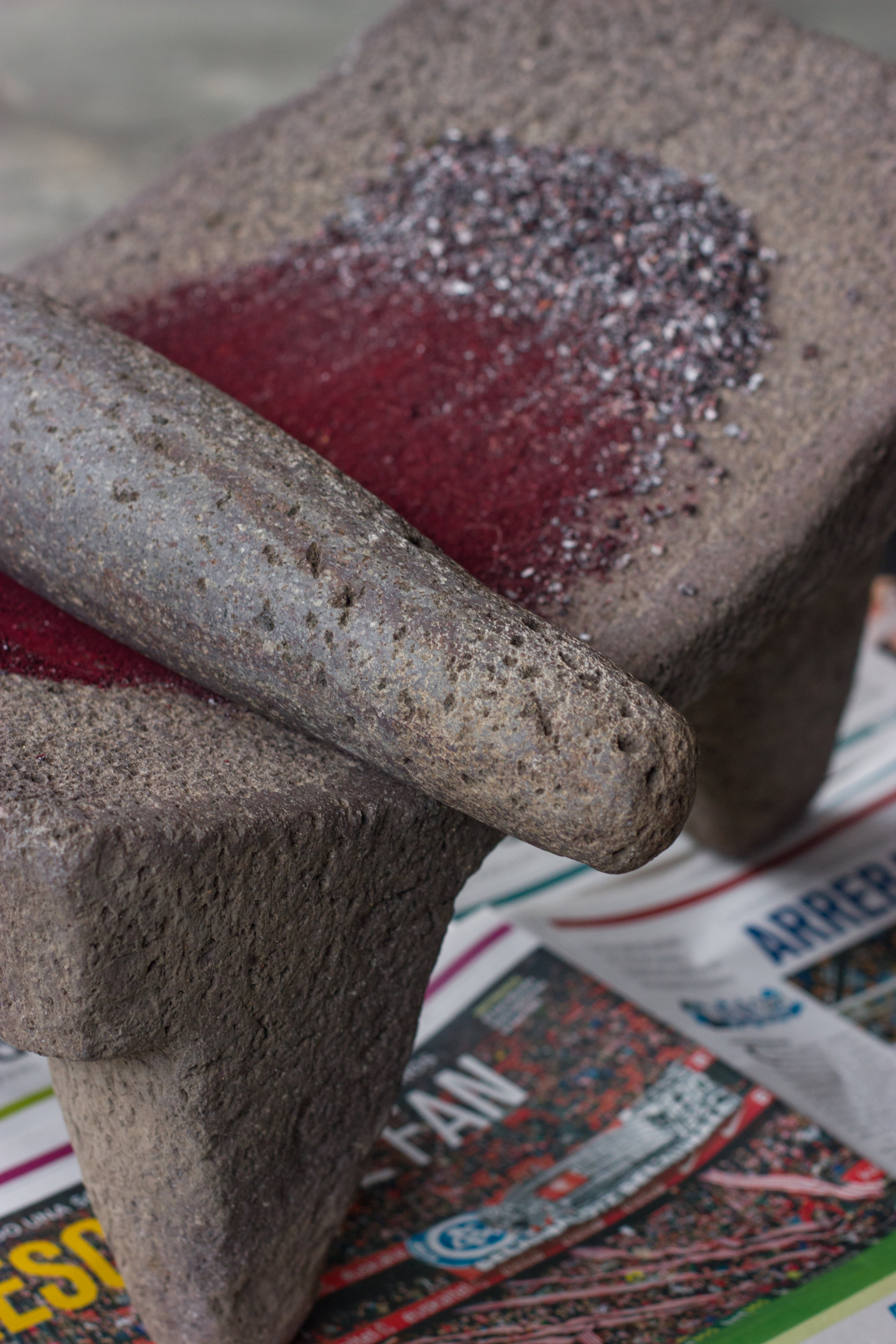 cochineal grining on metate in oaxaca by thread caravan
