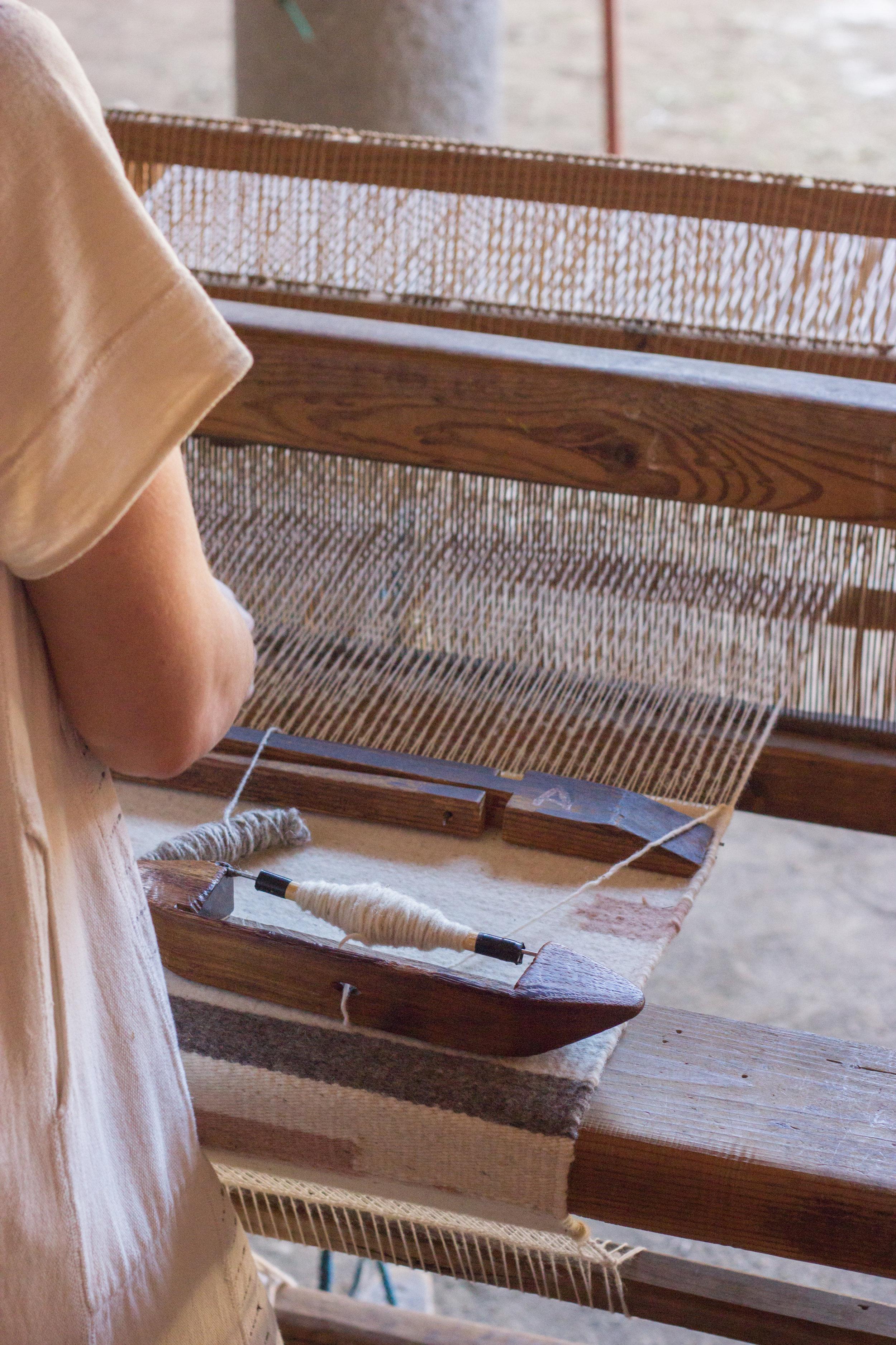 emily katz weaving on a footloom with thread caravan oaxaca