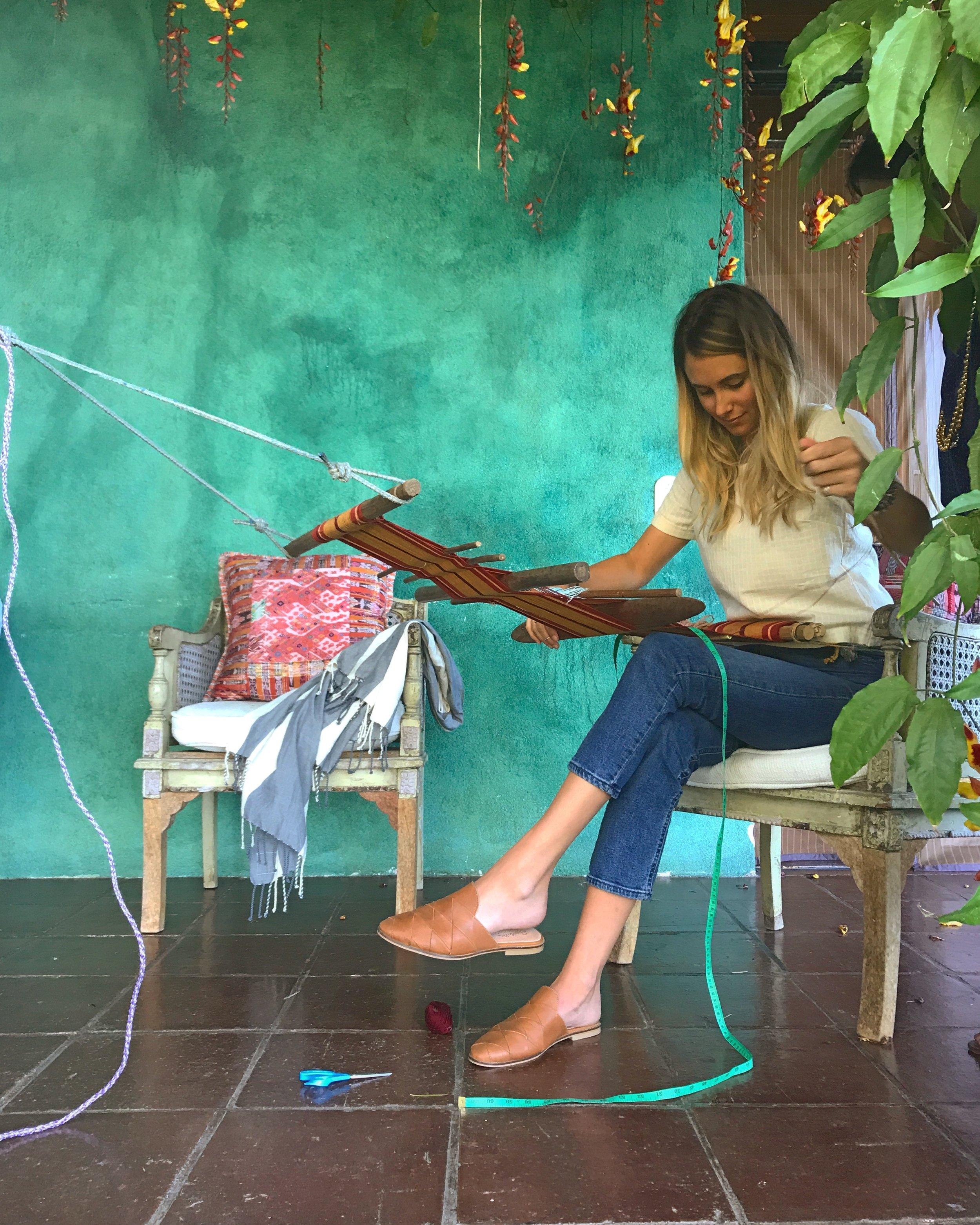 rachel weaving with thread caravan luna zorro in guatemala.jpg