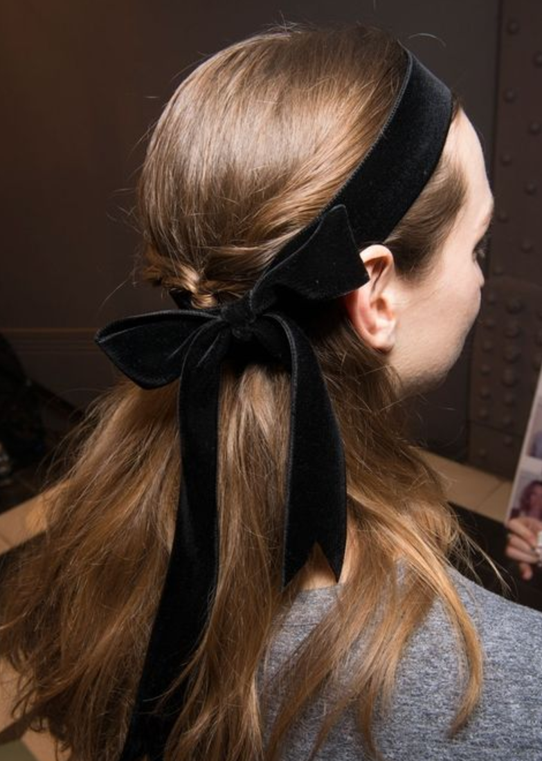 It's all about the bow - Ubiquitous on the runway this season, this gorgeous bow is a great addition and lovely way to stand out at your Fall parties. You can tie around the forehead or use as a ponytail to draw from this inspiration.Image courtesy of Temperly London)