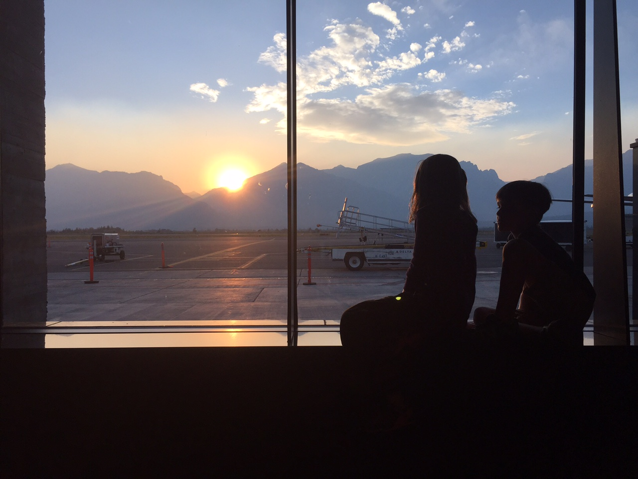 Samantha and Parker admire the sunset over the Tetons as they wait for Quimby's flight to arrive in Jackson Hole, Wy.