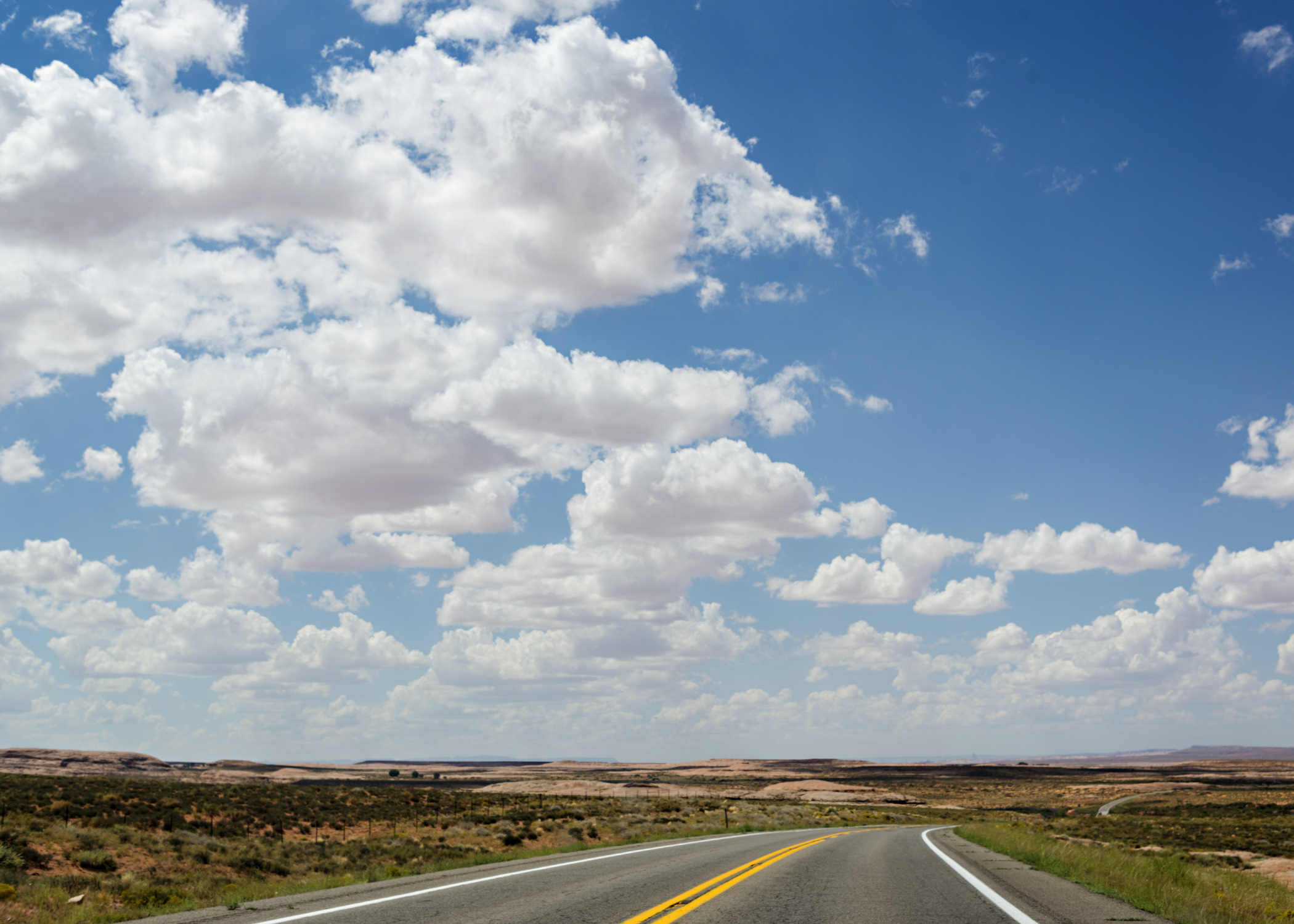 The sky stretches out over endless desert in the Four Corners region. Nikon D800, 24-120mm lens @ 44mm, iso 100, f6.3, 1/800 sec.