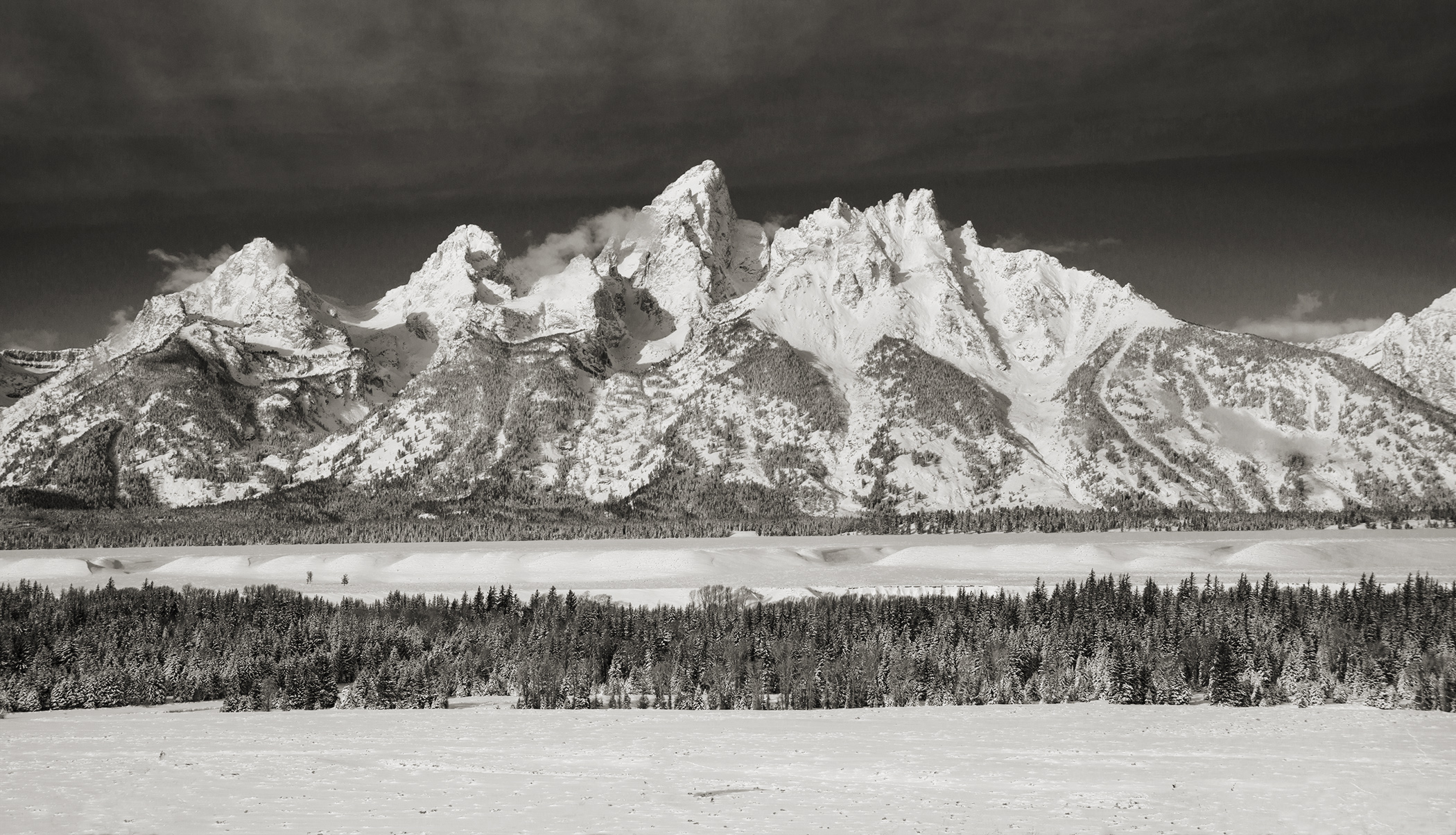 The Tetons are the most beautiful mountains any time of year, but wrap them in snow and it's game over.  Nikon D800, Nikon 28-200mm lens @ 50mm, ISO 125, f9, 1/640 sec.