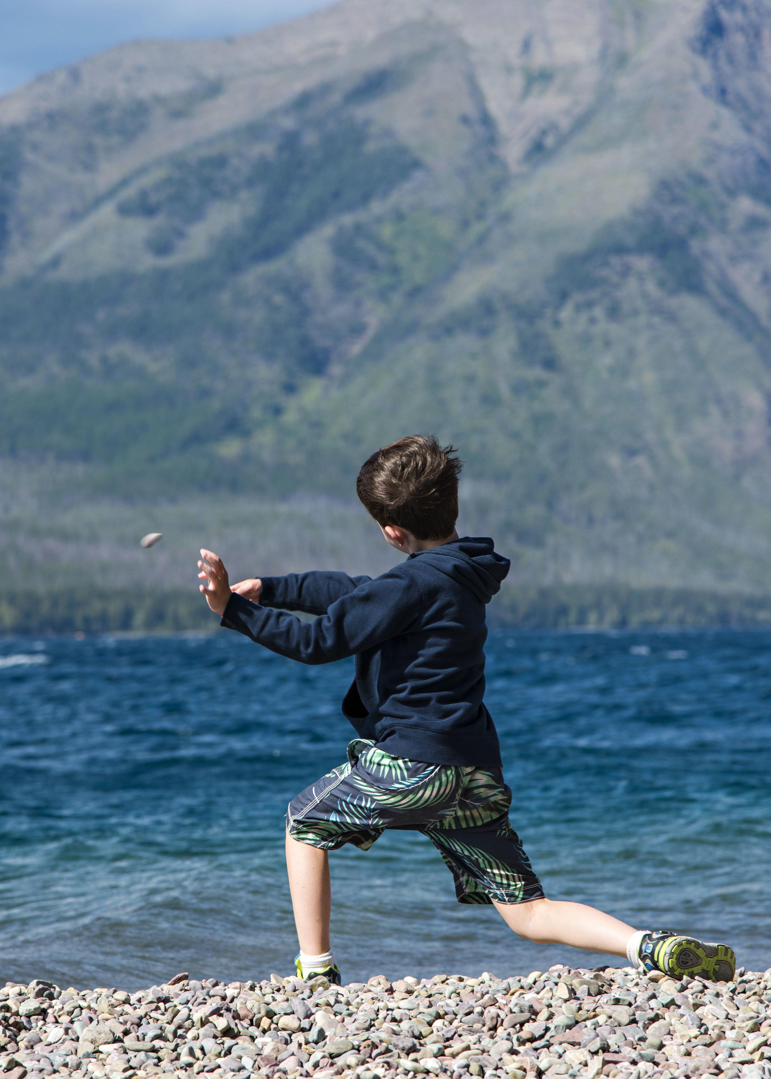 Parker skips stones on Lake McDonald, Glacier National Park. Nikon D800, Nikkor 24-120mm lens @ 120mm, ISO 100, f5.6, 1/500 sec.