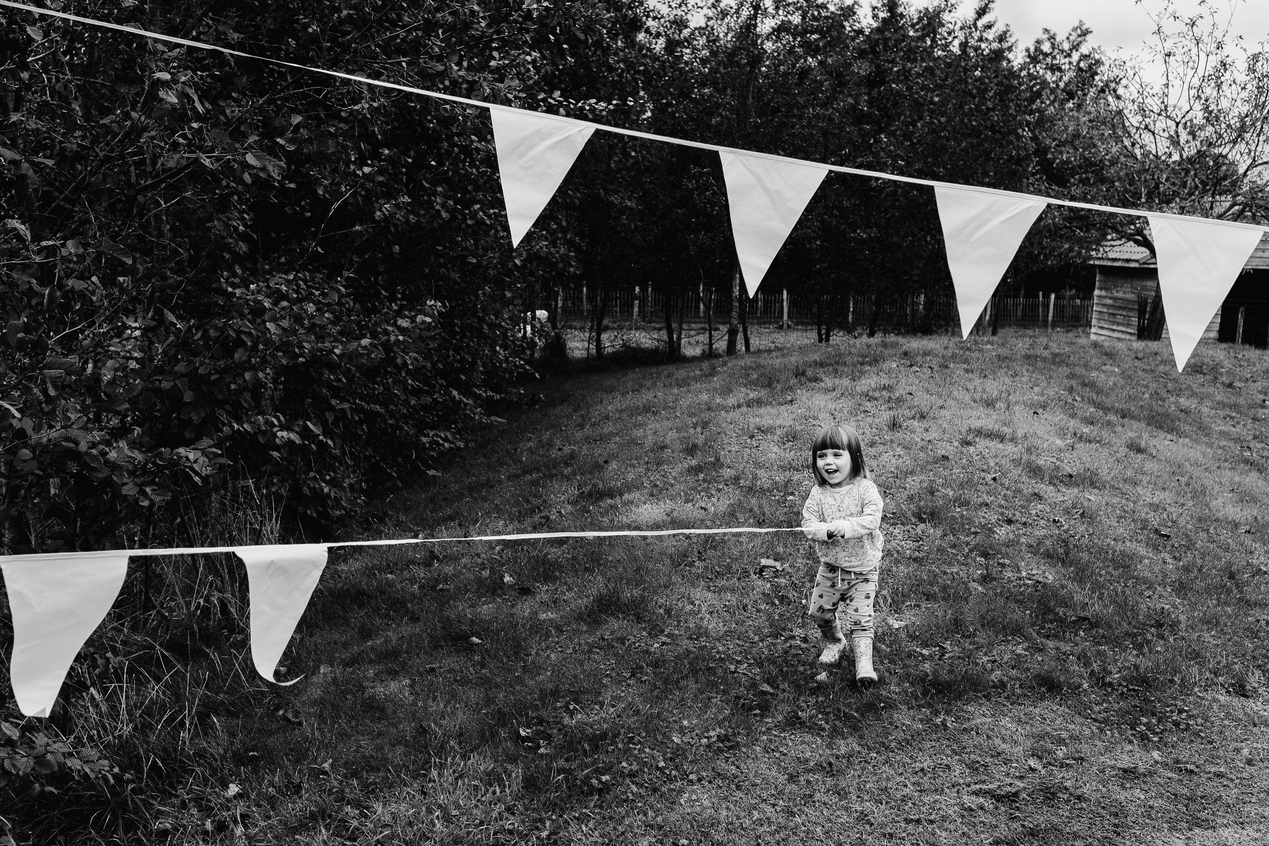 kid hanging flags