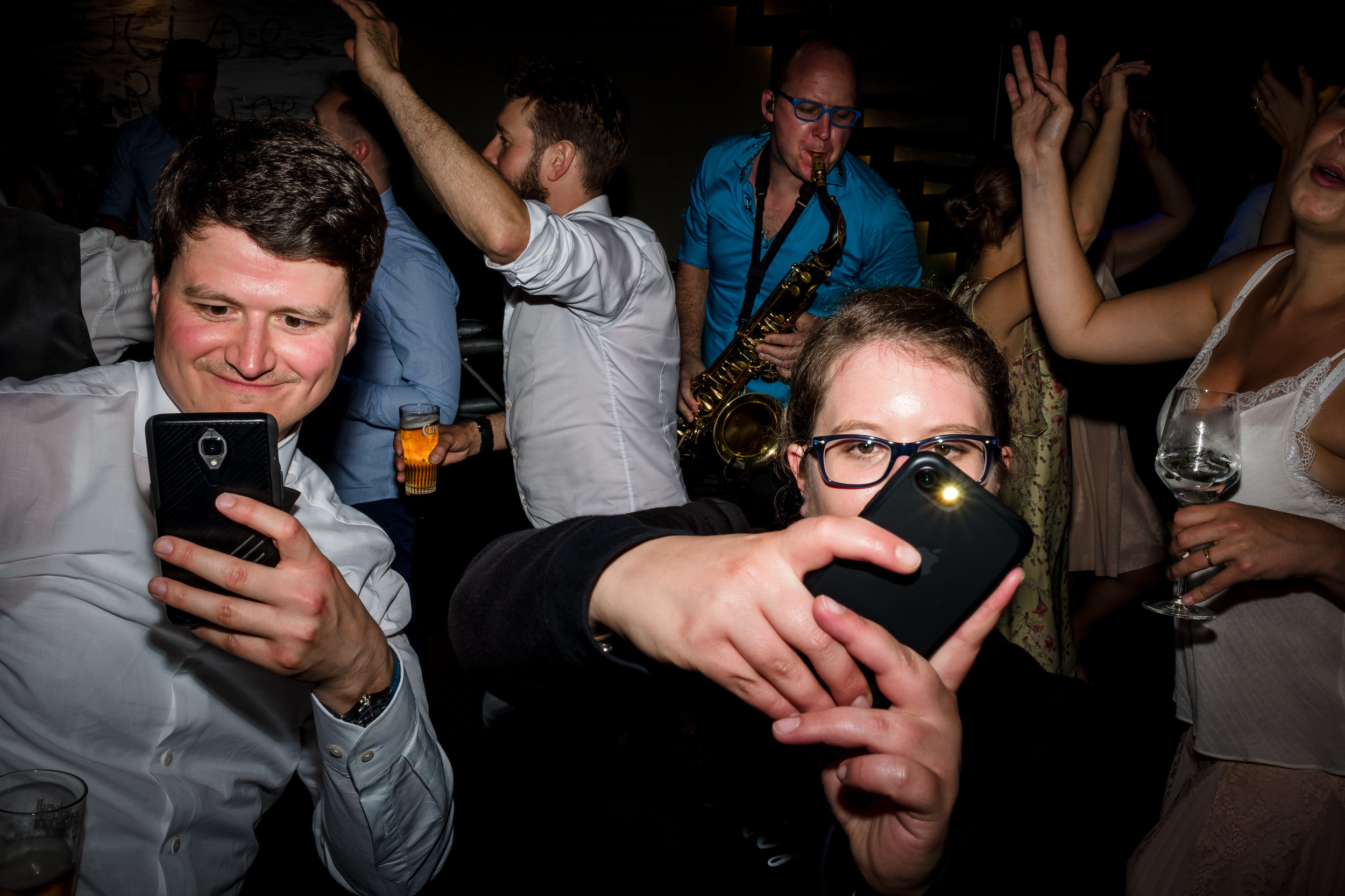 people at party with phones