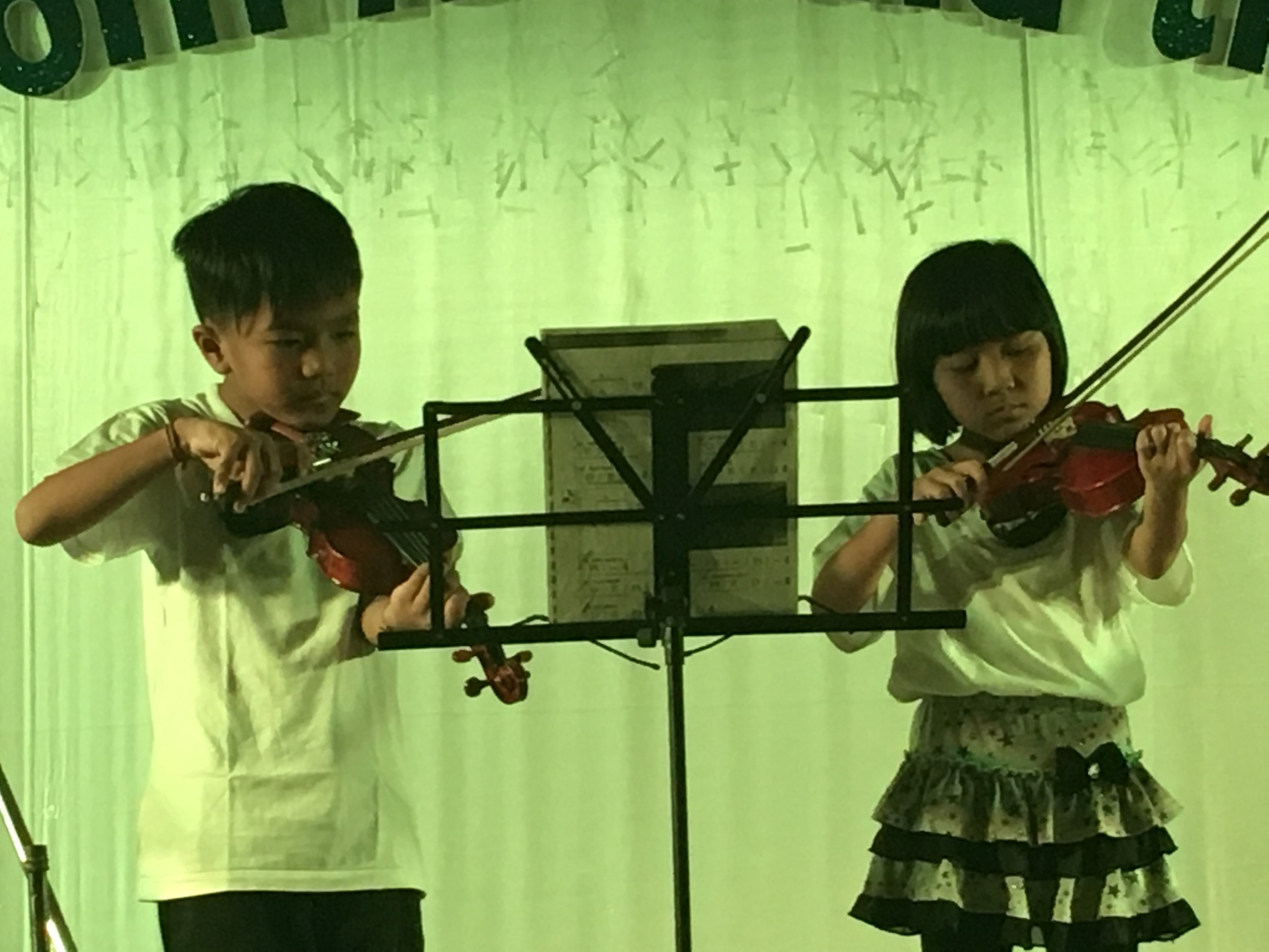 Grade 1 students on the violins at Music Show