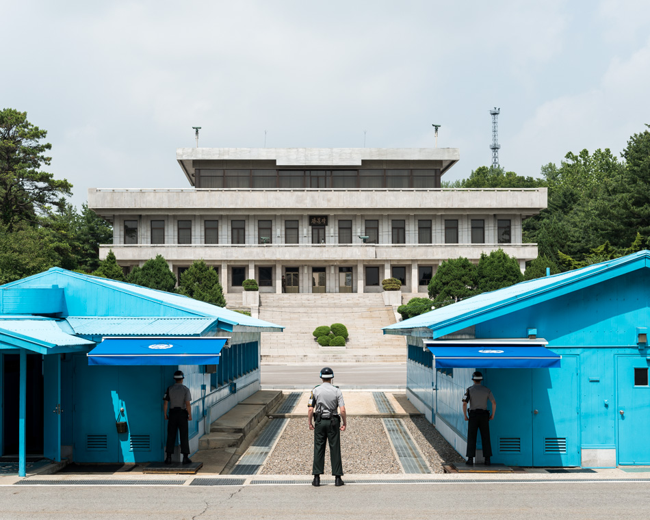 View from South Korea to North Korea at Panmunjom, the only point in the DMZ where the two sides meet. The concrete slabs in the middle of the huts mark the border between the two Koreas, and the blue buildings are where negotiations are held.