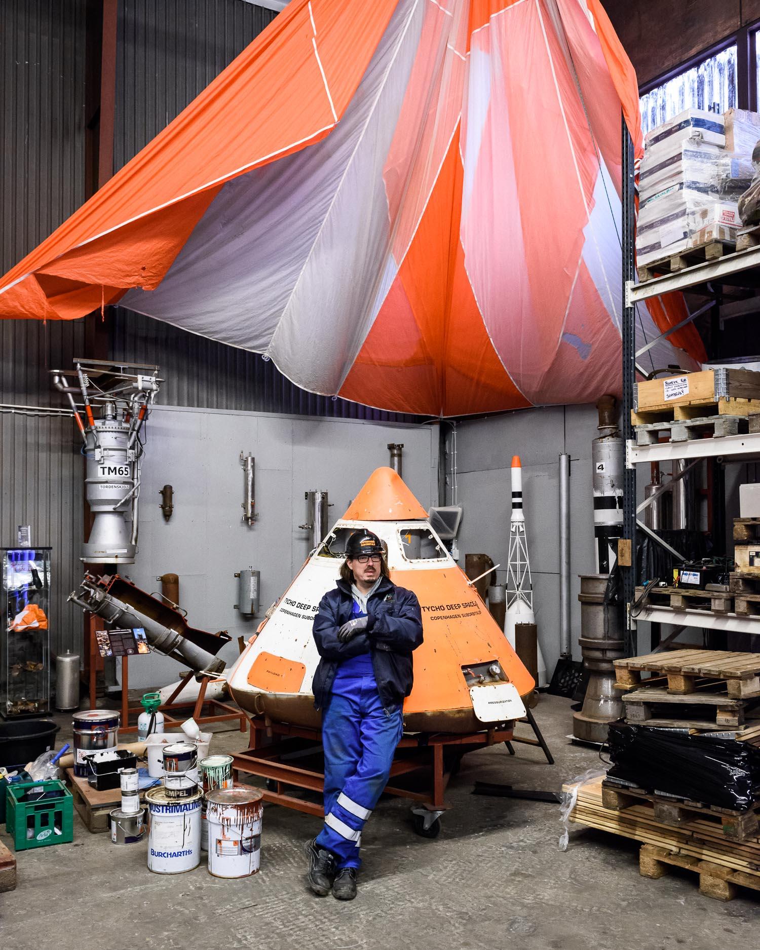 Mads Wilson of Copenhagen Suborbitals in front the Tycho Deep Space return capsule