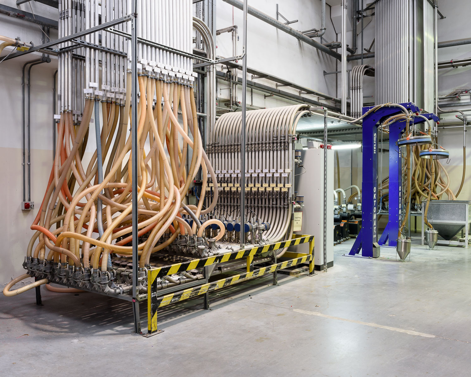 """""""The Octopus"""", a machine that sucks and blows plastic pellets around the factory."""