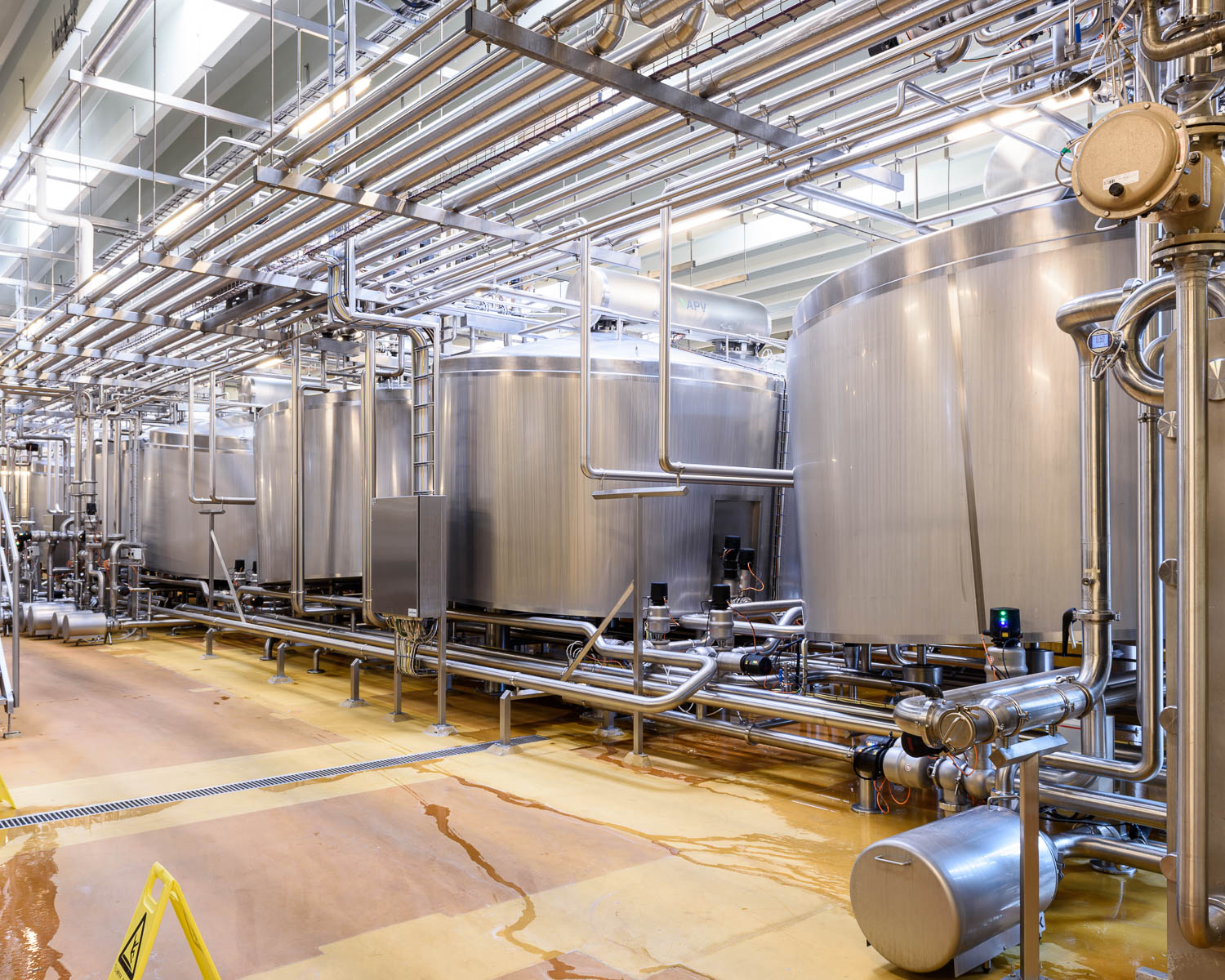 The milk is agitated in large tanks, separating the curds and whey