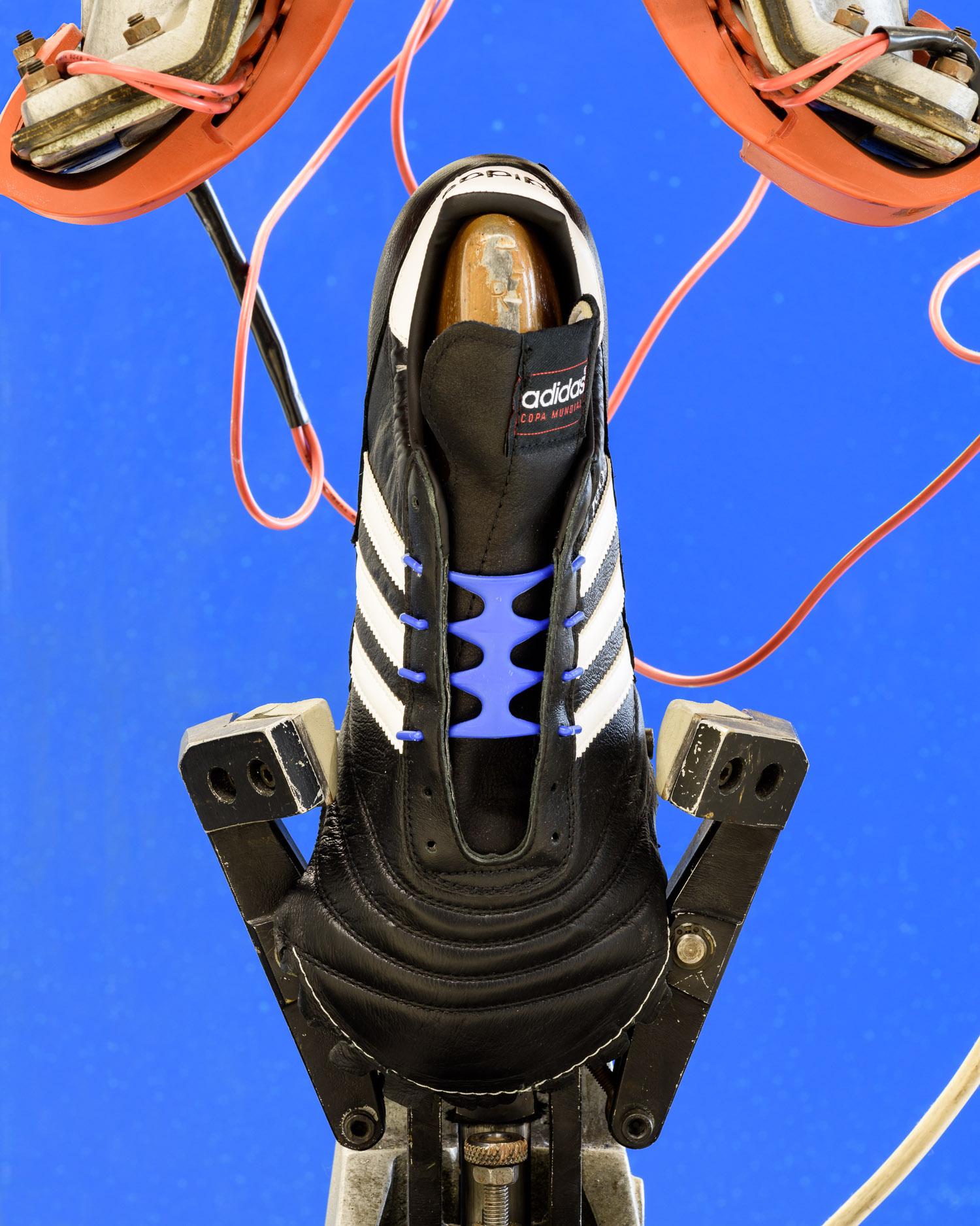 A Copa Mondial football boot on a machine in the Development Kitchen in Herzogenaurach