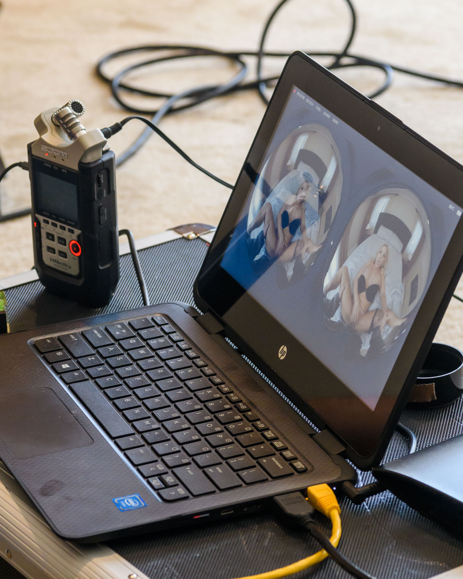 180 degree video from two cameras is previewed on a laptop on set.