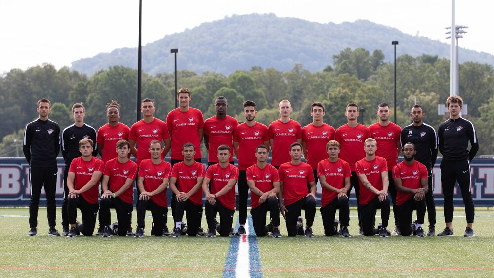 The University of the Cumberlands men's soccer team with two Soccer Smart players