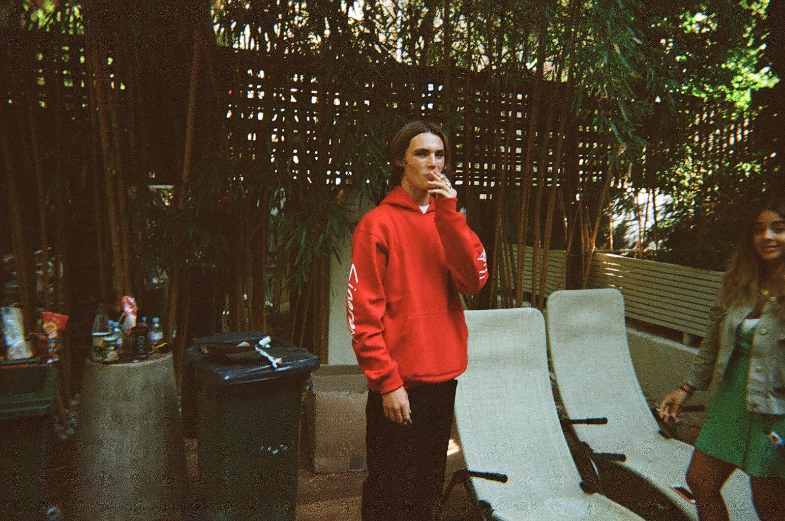 JAMES WOODROOF IN RED SIGEREX. HOODIE