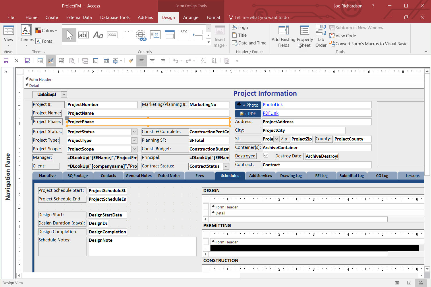An access database form in design view with fields, tabs and buttons