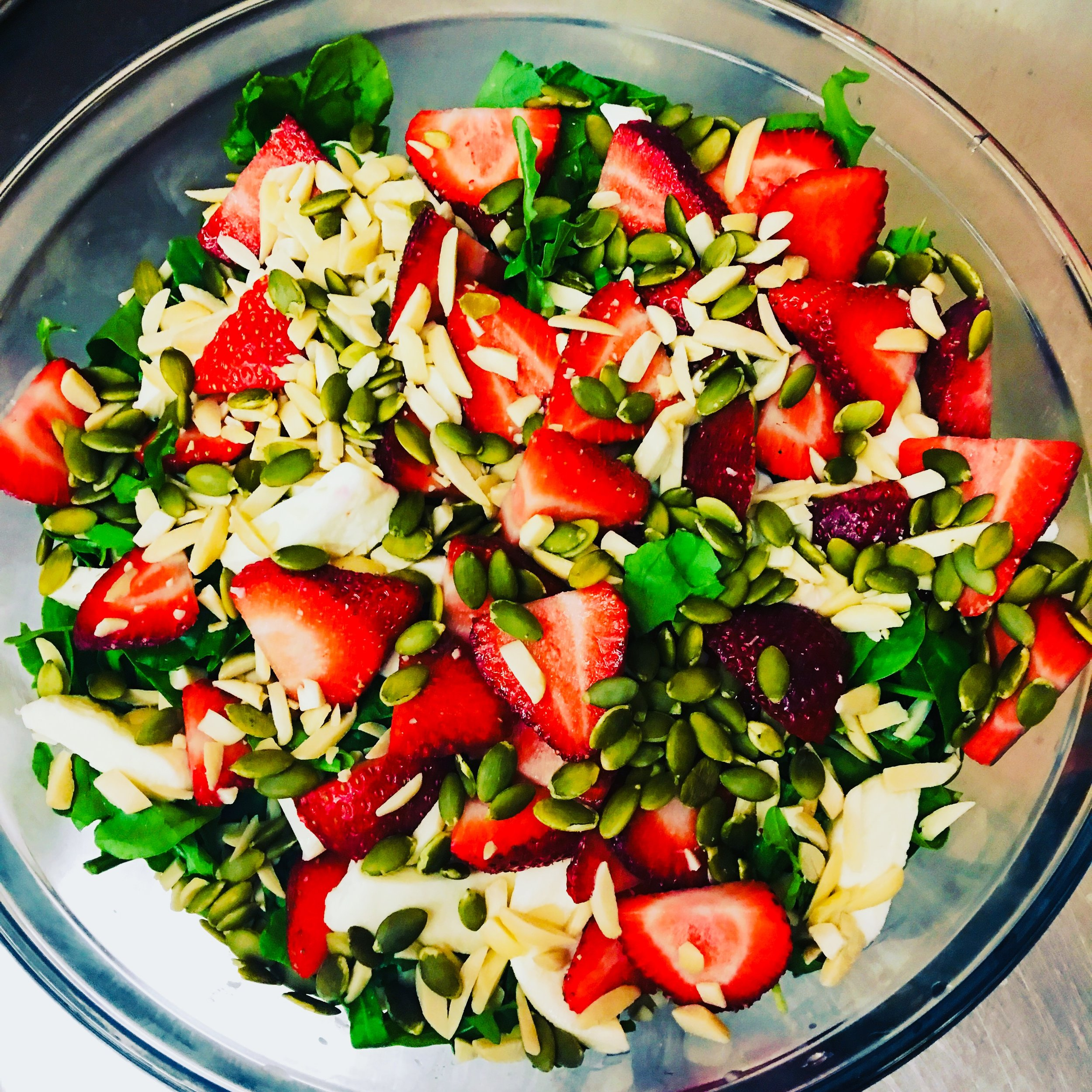 Juicy strawberries and crunchy pumpkin seeds. Add a little cheese, and you'll be pleased by this simple summer salad!